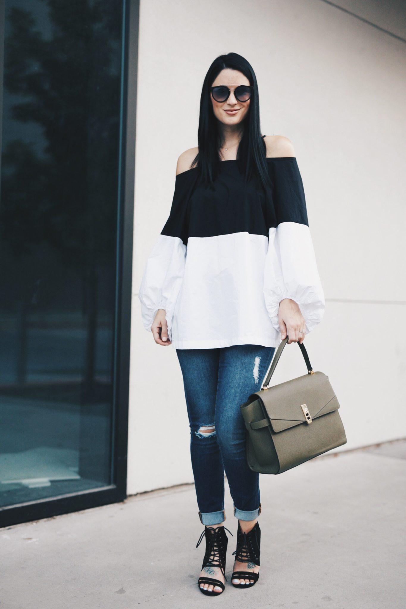 Olive Henri Bendel Bag, Black and White Top, Jeans
