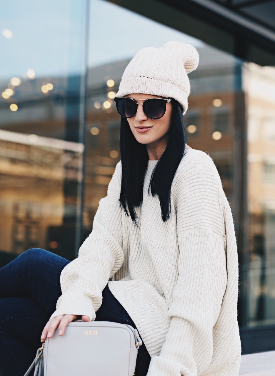 Ashley of DTKAustin is wearing a Chicwish Ivory open back sweater, a Gigi New York cross body bag, Steve Madden heels and Articles of Society Denim in Austin.
