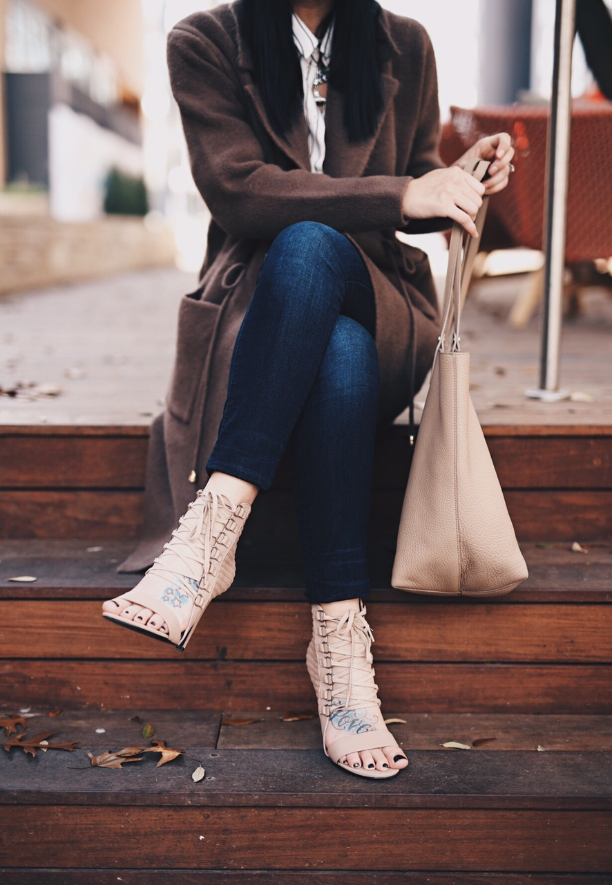 Ashley of DTKAustin is wearing a Chicwish coat with Lace up pumps from Revolve and a Gigi New York Tote.