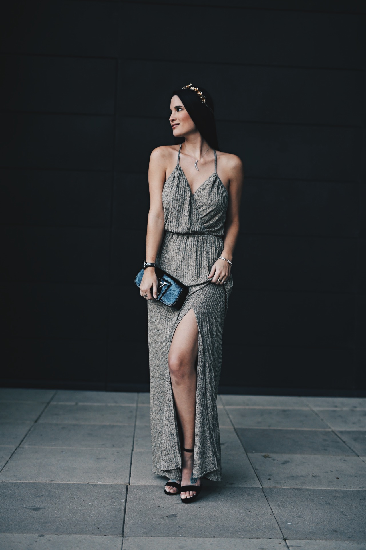 Ashley Hargrove of DTKAustin is wearing an Ella Moss Gold New Years Maxi Dress with a Louis Vuitton Clutch and flower crown