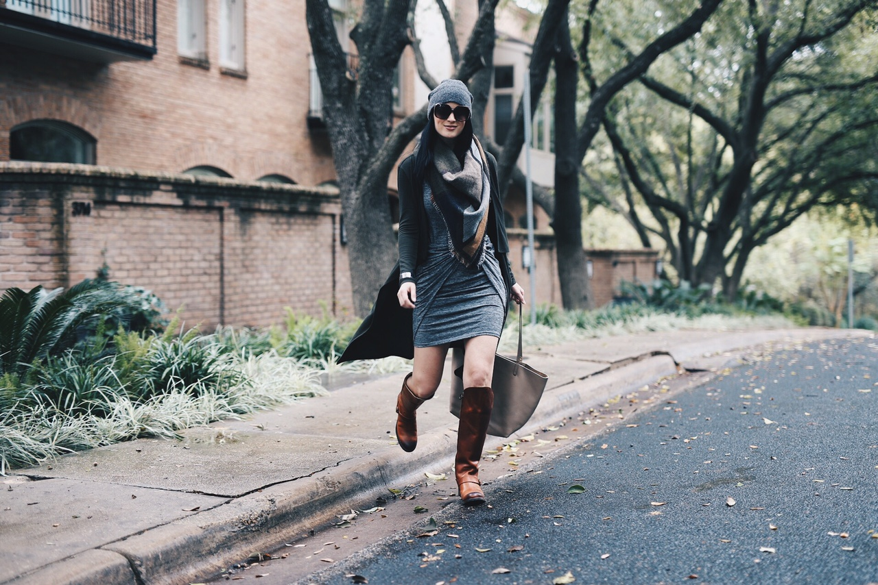 Ashley Hargrove of DTKAustin is wearing Justin Boots, Blanket Scarf from Nordstrom, a Gigi New York Tori Tote and Rebecca Minkoff Beanie