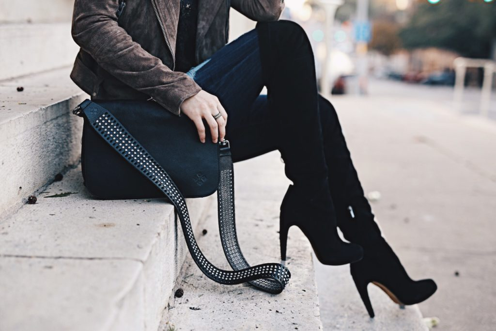Ashley Hargrove of DTKAustin is wearing a Patricia Nash leather crossbody from Macy's, Steve Madden over the knee boots and a BlankNYC leather jacket from Nordstrom.