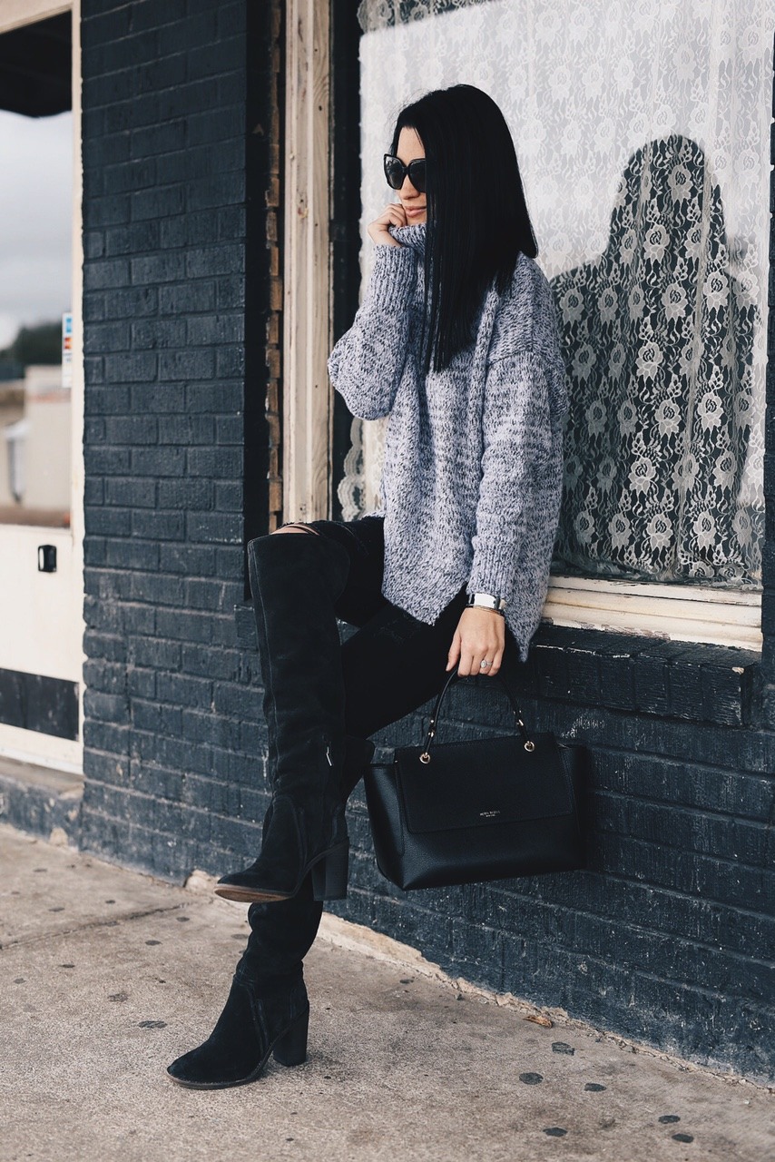 Ashley Hargrove of DTKAustin is wearing a Chicwish sweater, Henri Bendel Bag and Vince Camuto Boots