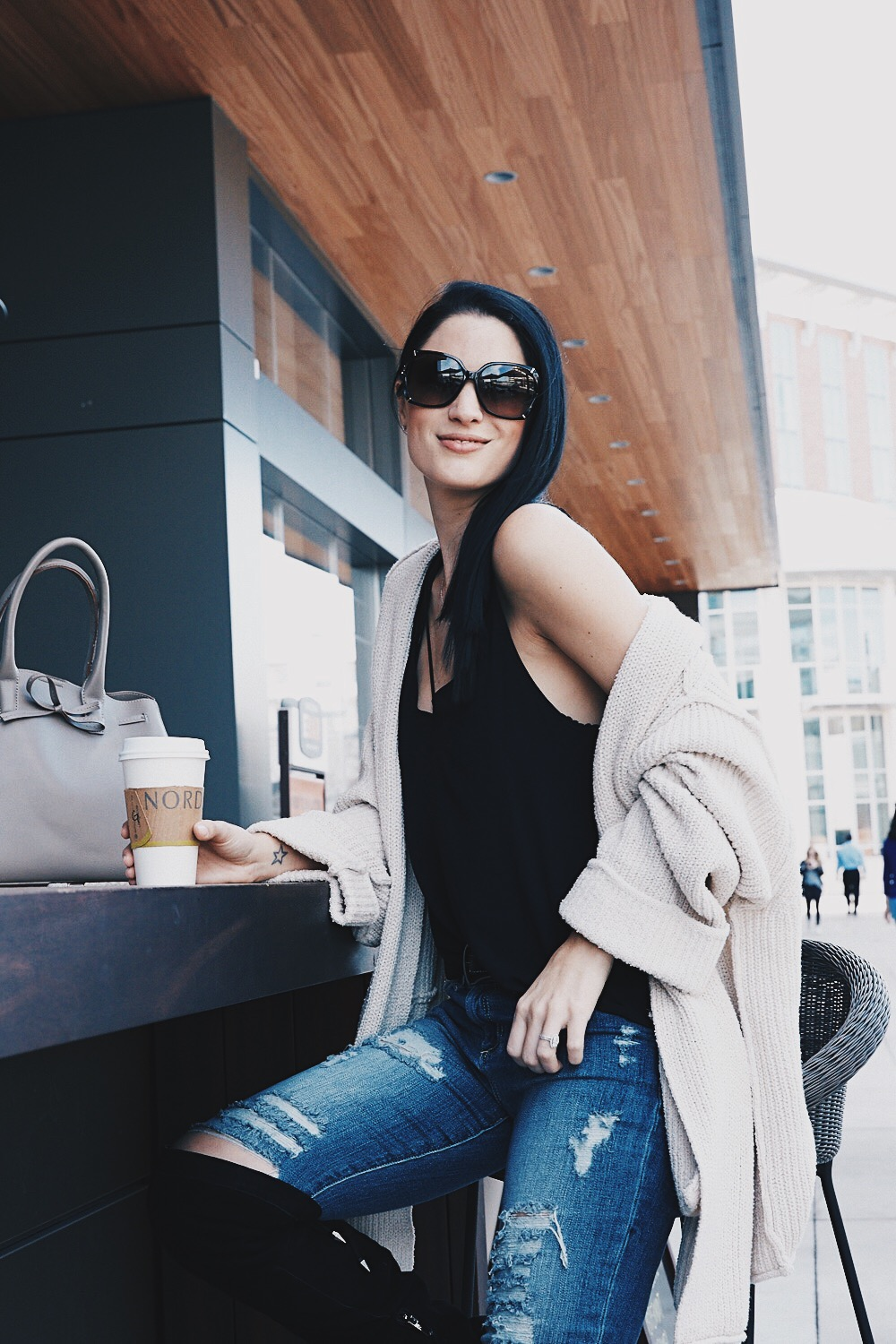 DTKAustin shows how to layer a cami with a knit cardigan and OTK boots for a cozy winter look. Click through for more outfit ideas!