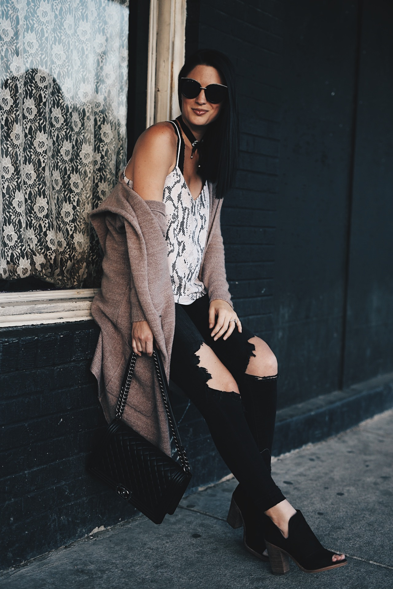 DTKAustin shows the 10 best booties under $100. If you're curious about how to layer a cami and cardigan for winter click for more info!