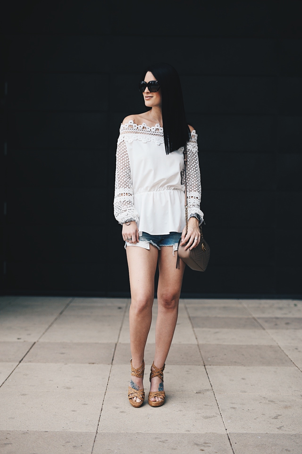 DTKAustin shows us how to wear the highly coveted off-the-shoulder trend with Chicwish, cutoff shorts and wedges from Stuart Weitzman. Want more summer inspiration? Click to get more details!