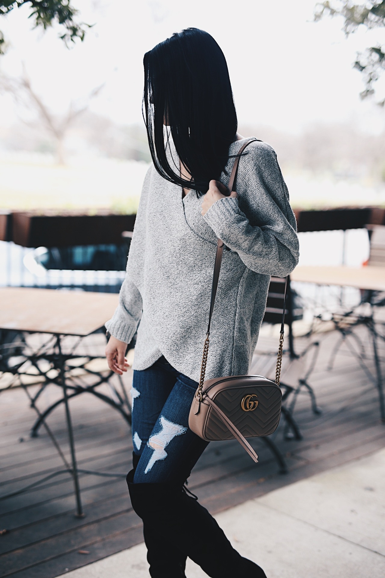 DTKAustin shares her favorite casual Winter look. Ashley is wearing a Chicwish sweater, Express jeans, Gucci Marmont Bag and OTK Boots. Click for more outfit details!
