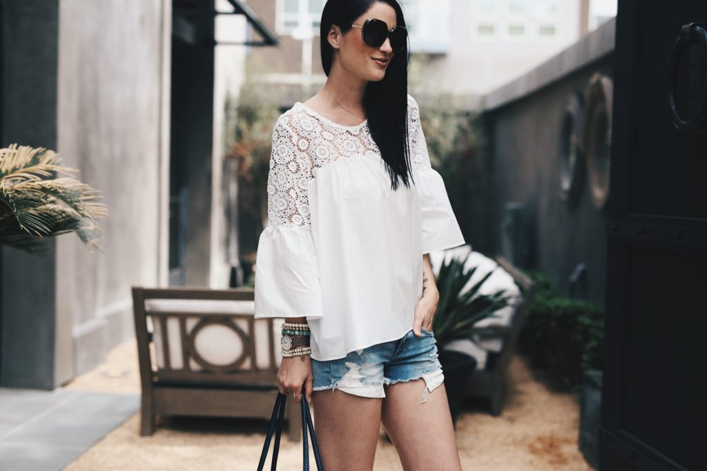 DTKAustin shares her favorite summer outfit. Chicwish top, American eagle cut off shorts, Frye shoes and tote. Click for more details on the perfect summer look!