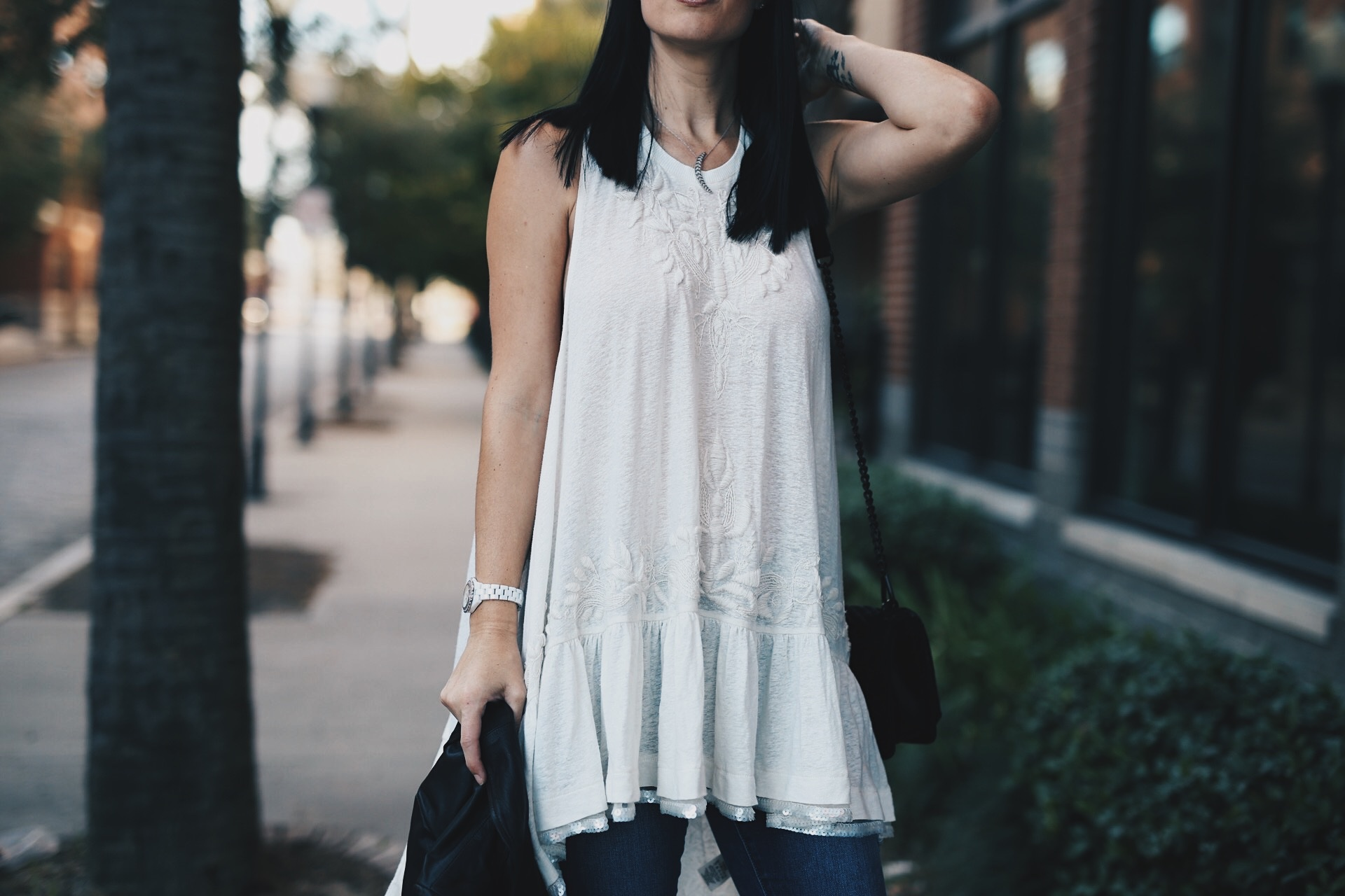 DTKAustin is sharing her favorite white free people top shot while in New Orleans. Ashley is carrying a Rebecca Minkoff Love bag and wearing Vince Camuto OTK Boots. Click to get more info and pics!