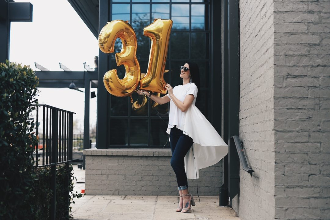 DTK Austin is celebrating her 31st birthday by sharing 31 facts about her life. Click for more outfit details - Blouse from Red Dress Boutique, Steve Madden heels, Articles of Society Jeans with a Henri Bendel Bag.