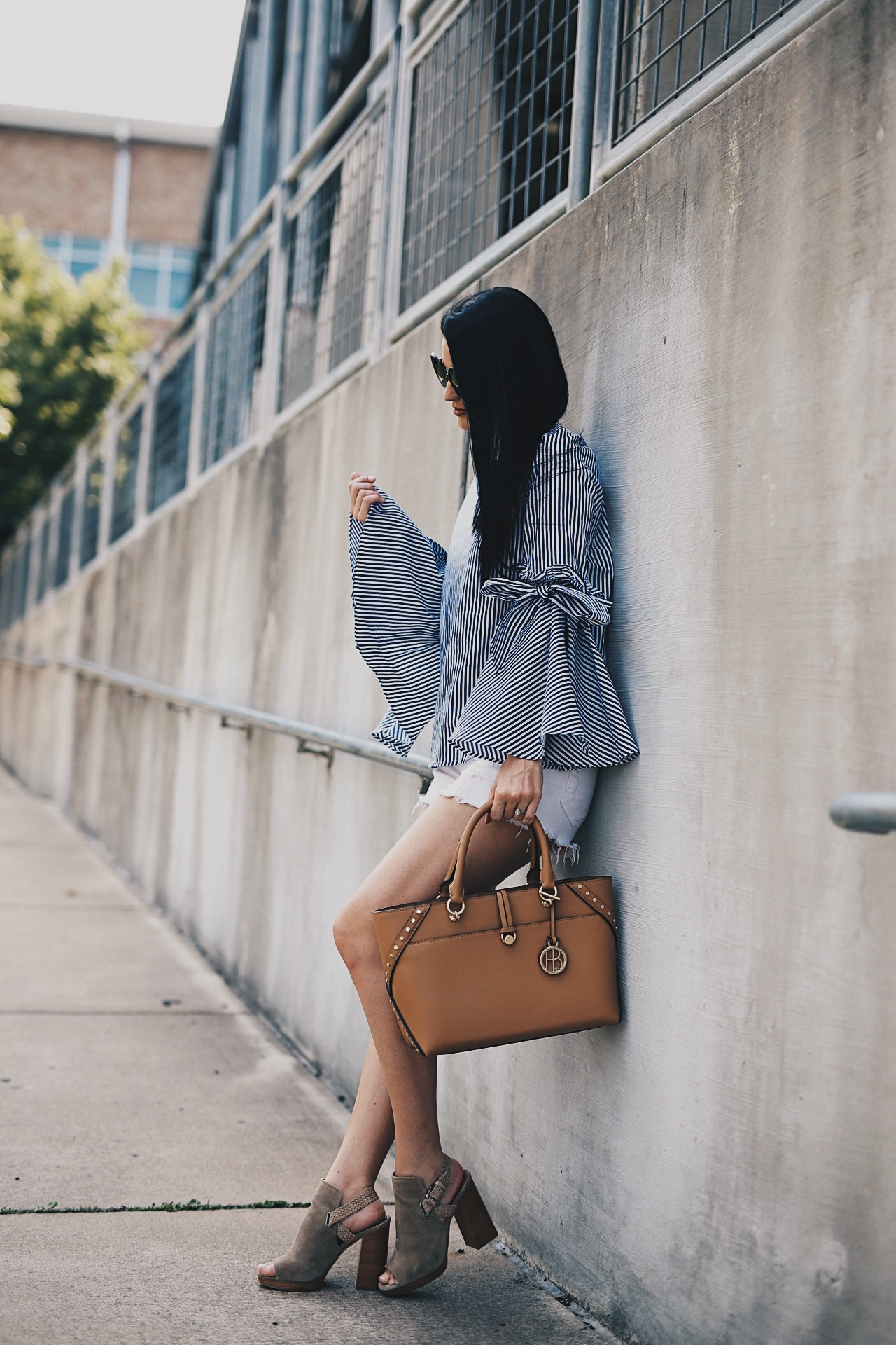 Ashley of DTK Austin shares her favorite summer bell-sleeved top from Chicwish with a Henri Bendel tote. Click for more information and photos of the perfect summer outfit.