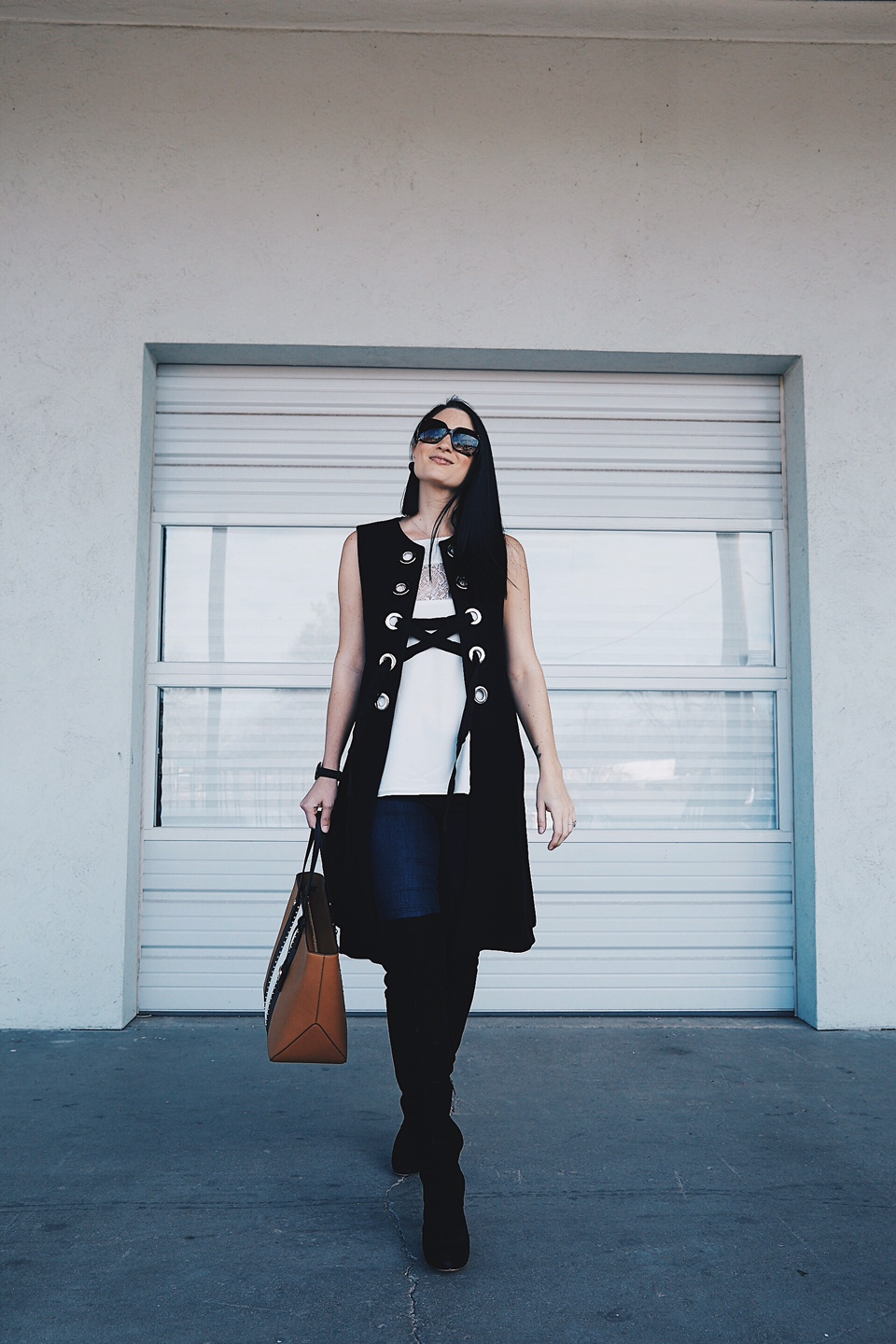 DTKAustin shows how to wear a vest to transition into Spring. Click for more details on this OOTD. Zara Vest, Henri Bendel Bag, and a CamiNYC tank.