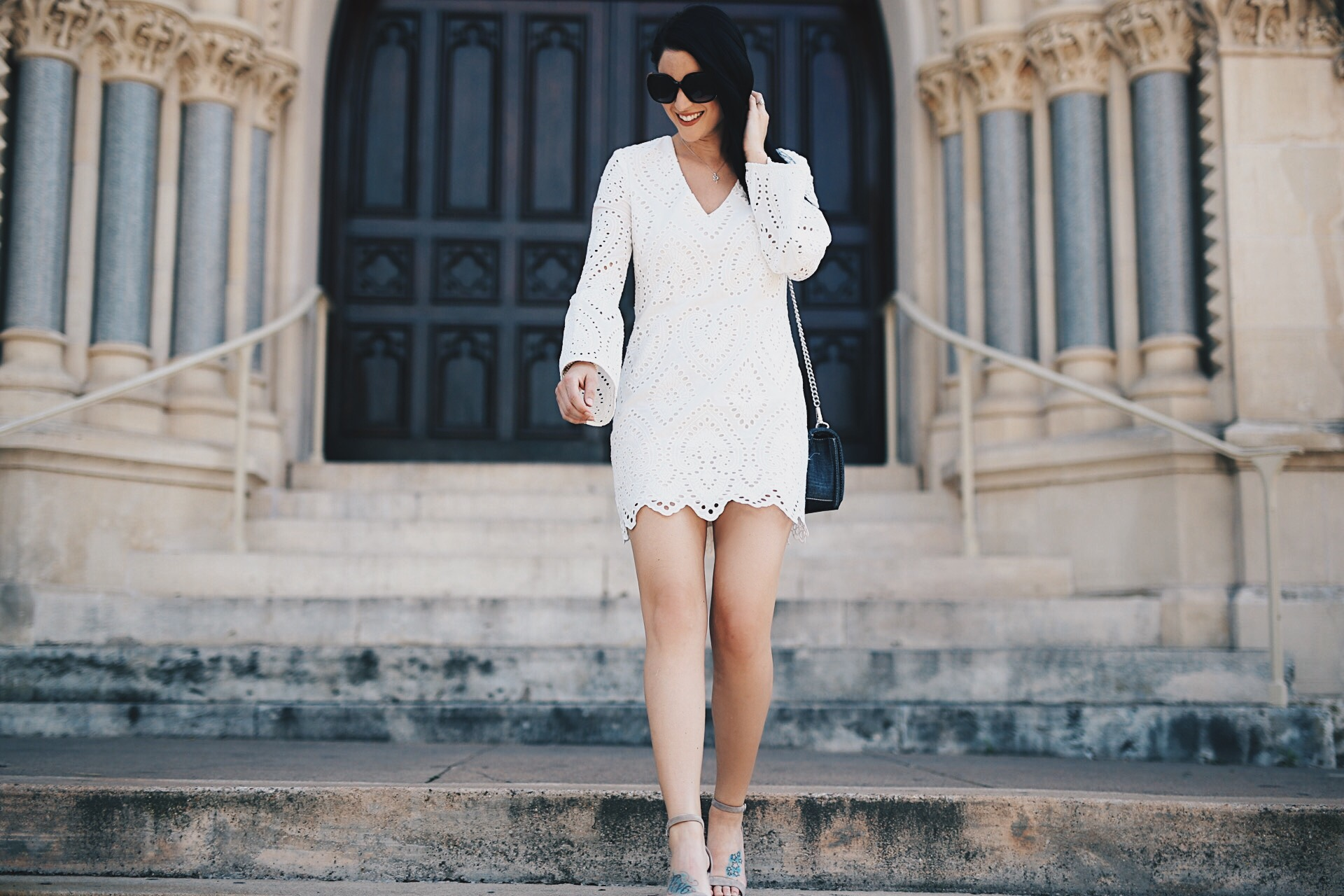 Cute Easter Dresses featured by top US fashion blog Dressed to Kill; Image of a woman wearing WAYF dress, Steve Madden shoes, Rebecca Minkoff handbag and Nordstrom sunglasses.