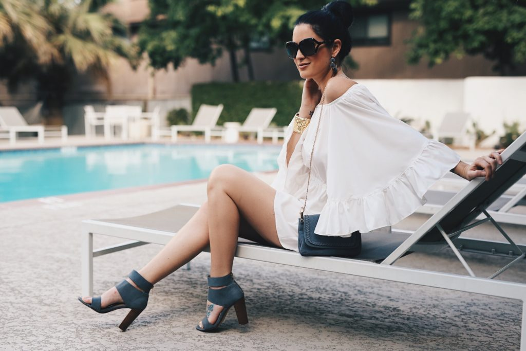 DTKAustin is sharing one of her go-to outfits for a gorgeous summer day by the pool in Texas! This romper works perfectly as a bathing suit coverup or a cute outfit on its own. Click for more details and photos.