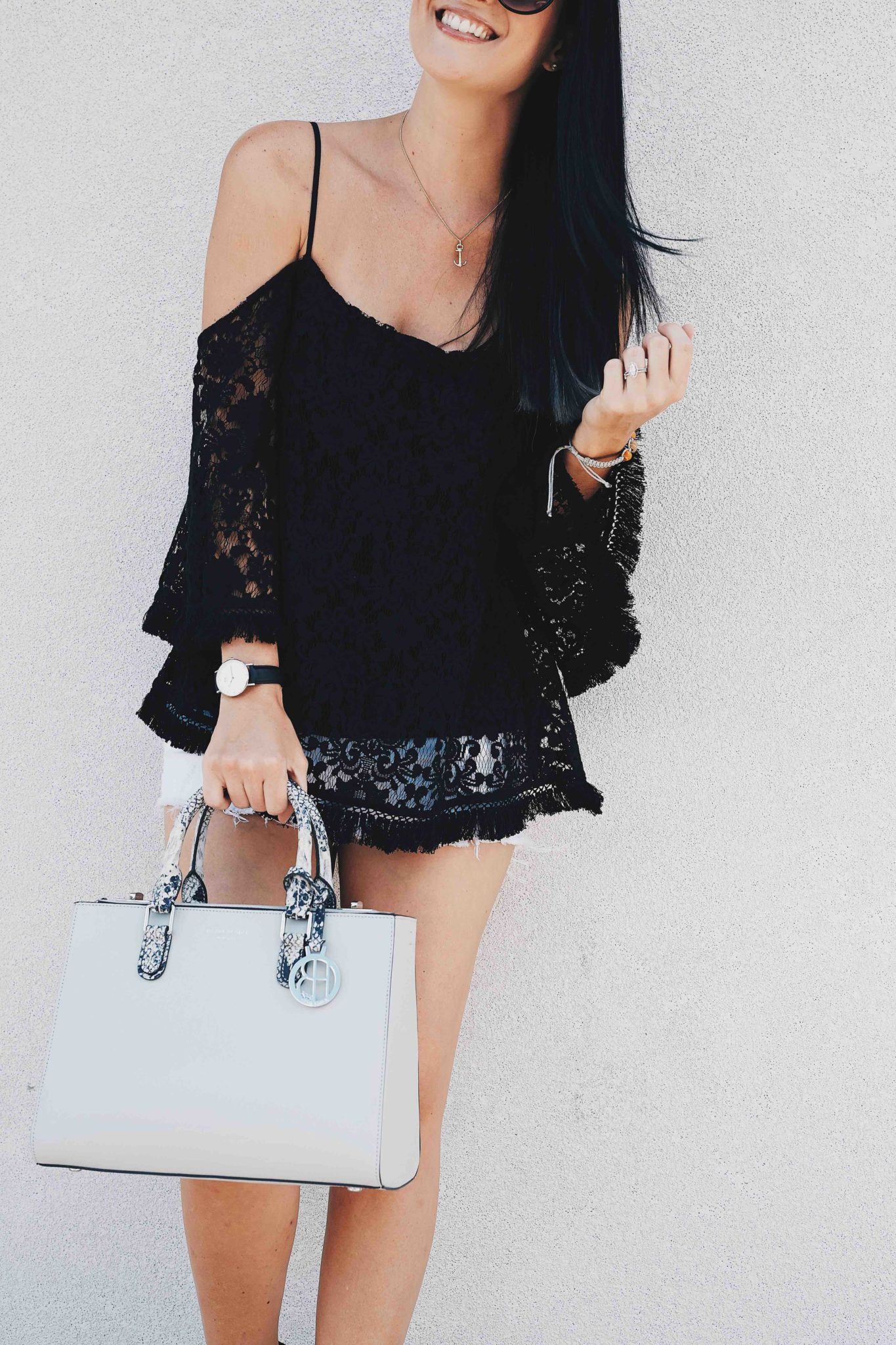 DTKAustin shares a beautiful black Bailey44 lace cold shoulder top, paired with white cutoff shorts, a Henri Bendel bag and Splendid black heels. Click for more information and photos. | how to style a cold shoulder top | how to wear a cold shoulder top | cold shoulder top style tips | summer fashion tips | summer outfit ideas | summer style tips | what to wear for summer | warm weather fashion | fashion for summer | style tips for summer | outfit ideas for summer || Dressed to Kill