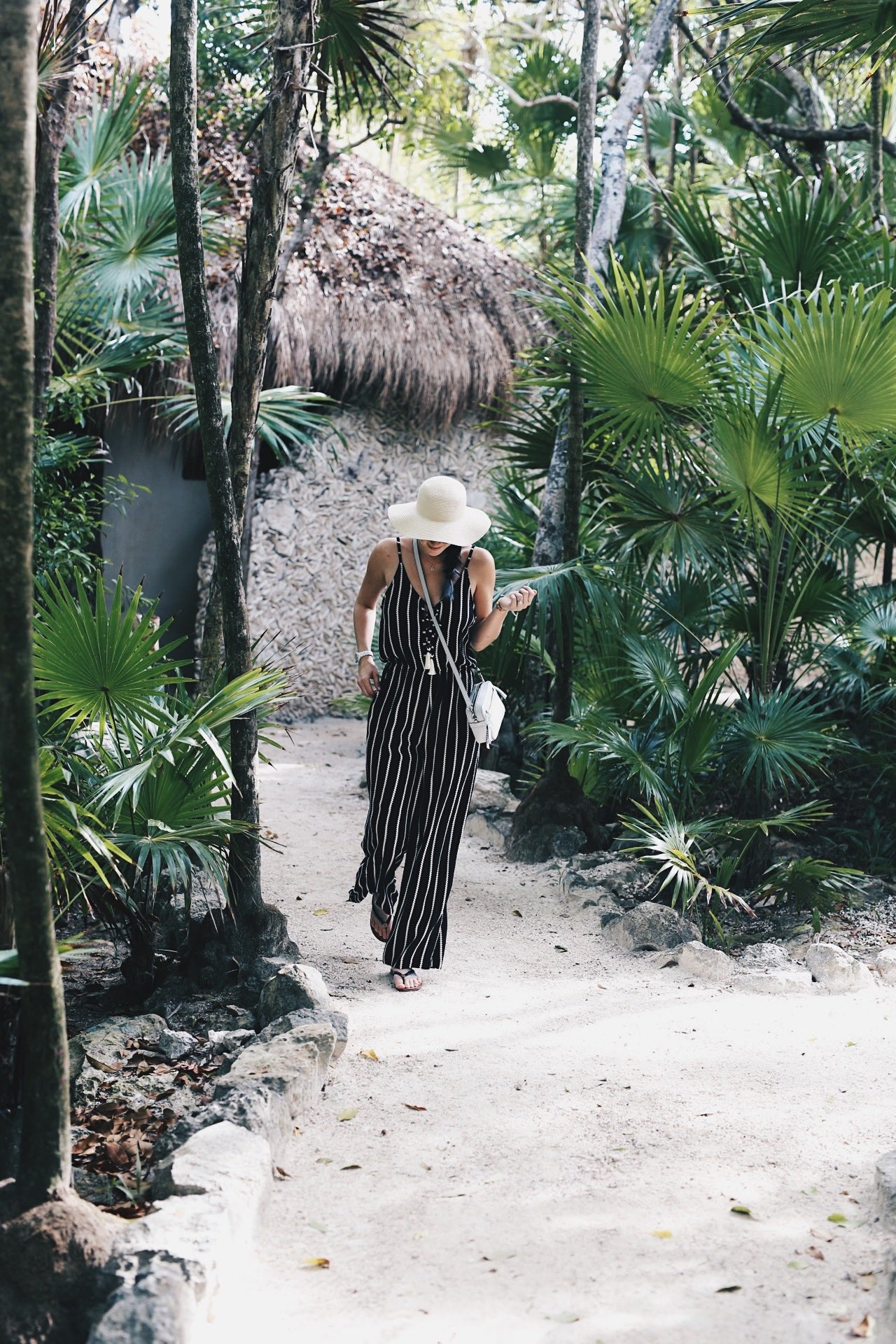 DTKAustin shares some of her recent photos from Tulum, Mexico with ideas on what to wear to beat the heat in the jungle or on the beach. Jumpsuit from Wala Swim, Bag from Henri Bendel. Click for more images and information. | how to style a jumpsuit | how to wear a jumpsuit | jumpsuit styling tips | summer fashion tips | summer outfit ideas | summer style tips | what to wear for summer | warm weather fashion | fashion for summer | style tips for summer | outfit ideas for summer || Dressed to Kill