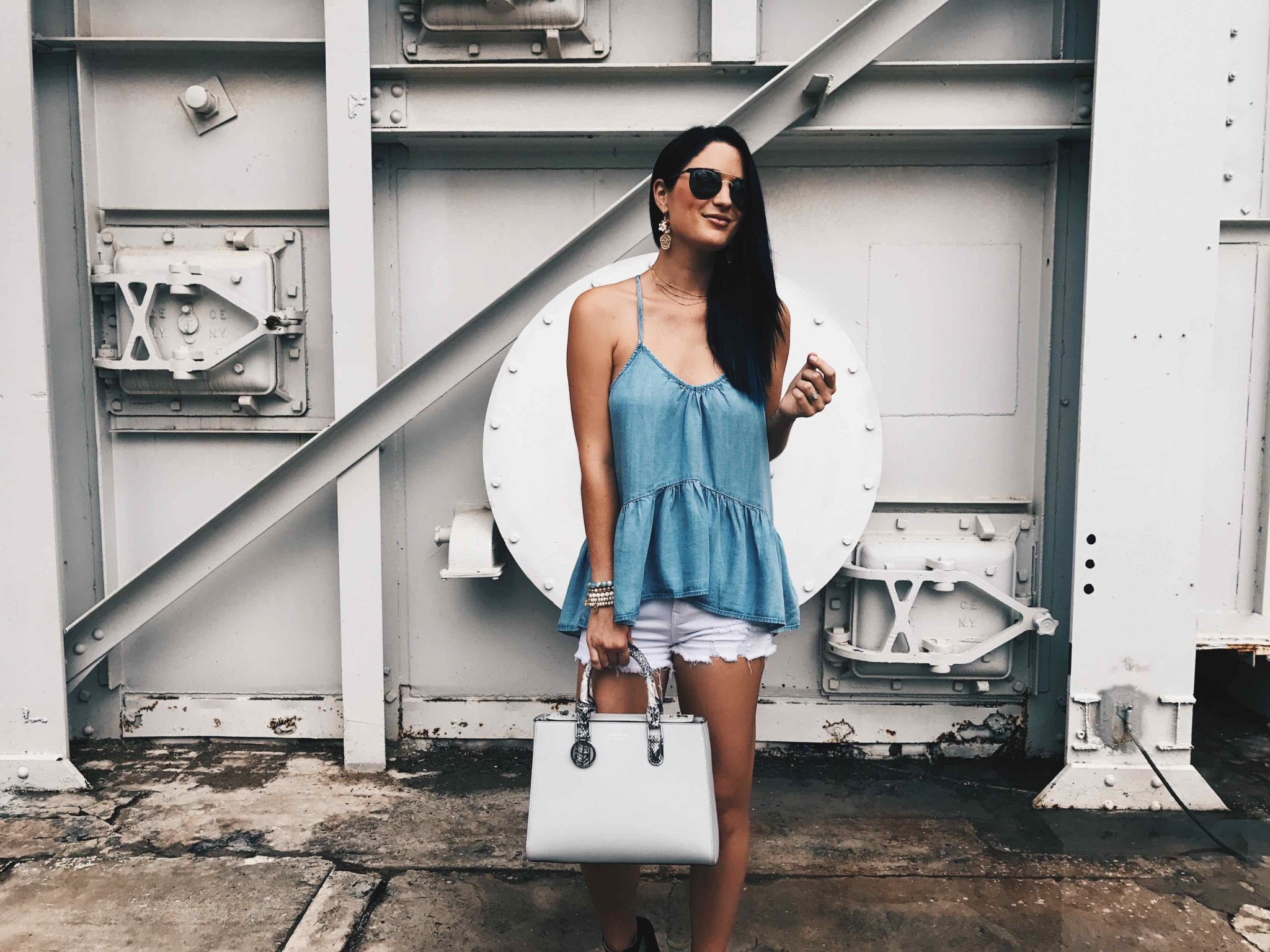 DTKAustin shares her go-to casual outfit for Sunday brunch in Austin. Chambray top by Lux & the Moon, Bag by Henri Bendel, jewelry from Baublebar. Click for more information and photos. | how to style a peplum top | how to wear a peplum top | how to wear white cutoff shorts | how to style white cutoff shorts peplum top style tips | summer fashion tips | summer outfit ideas | summer style tips | what to wear for summer | warm weather fashion | fashion for summer | style tips for summer | outfit ideas for summer || Dressed to Kill