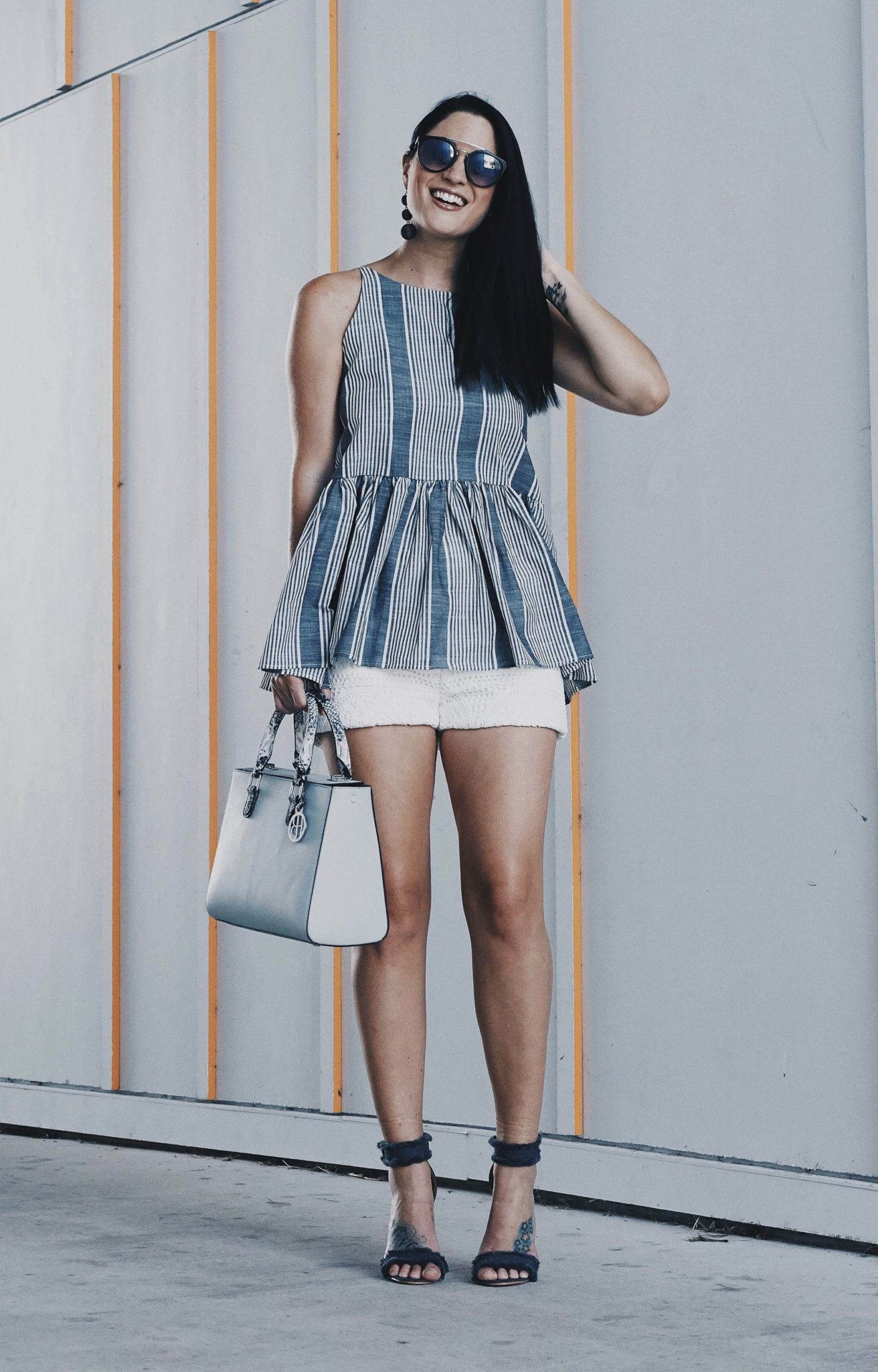 DTKAustin shares her go-to casual summer look for any occasion. Top from Nordstrom, Shorts from Chicwish, handbag from Henri Bendel. Click for more images and info! | how to wear a peplum | peplum top style tips | summer fashion tips | summer outfit ideas | summer style tips | what to wear for summer | warm weather fashion | fashion for summer | style tips for summer | outfit ideas for summer || Dressed to Kill