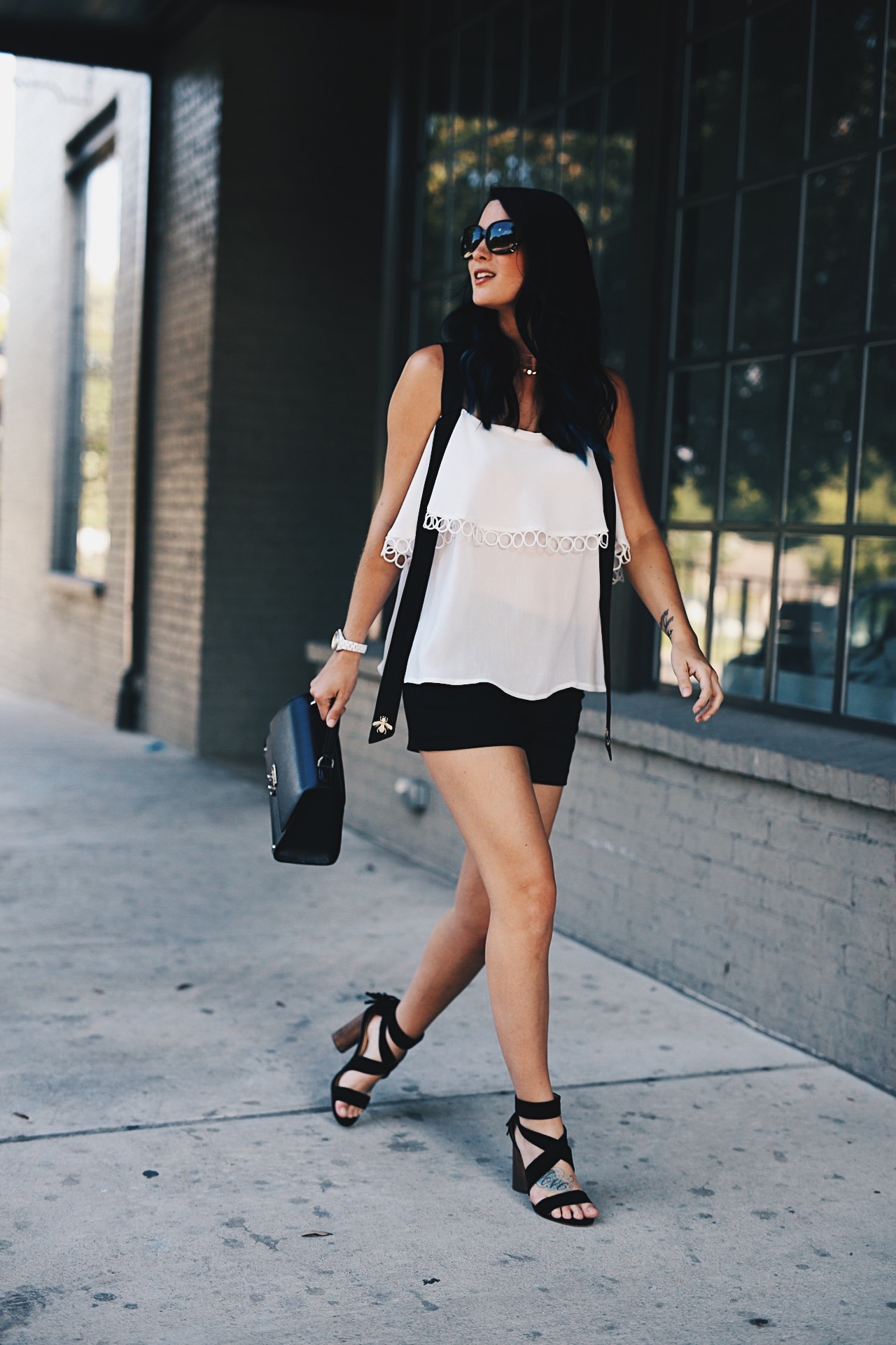 DTKAustin shares her love for black and white with this bee detailed top from Chicwish. Shoes from Splendid, Shorts from Alice & Olivia and bag from Henri Bendel. Click for more details and photos.  | how to style a cold shoulder top | how to wear a cold shoulder top | cold shoulder top style tips | summer fashion tips | summer outfit ideas | summer style tips | what to wear for summer | warm weather fashion | fashion for summer | style tips for summer | outfit ideas for summer || Dressed to Kill