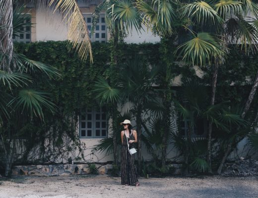 DTKAustin shares some of her recent photos from Tulum, Mexico with ideas on what to wear to beat the heat in the jungle or on the beach. Jumpsuit from Wala Swim, Bag from Henri Bendel. Click for more images and information.