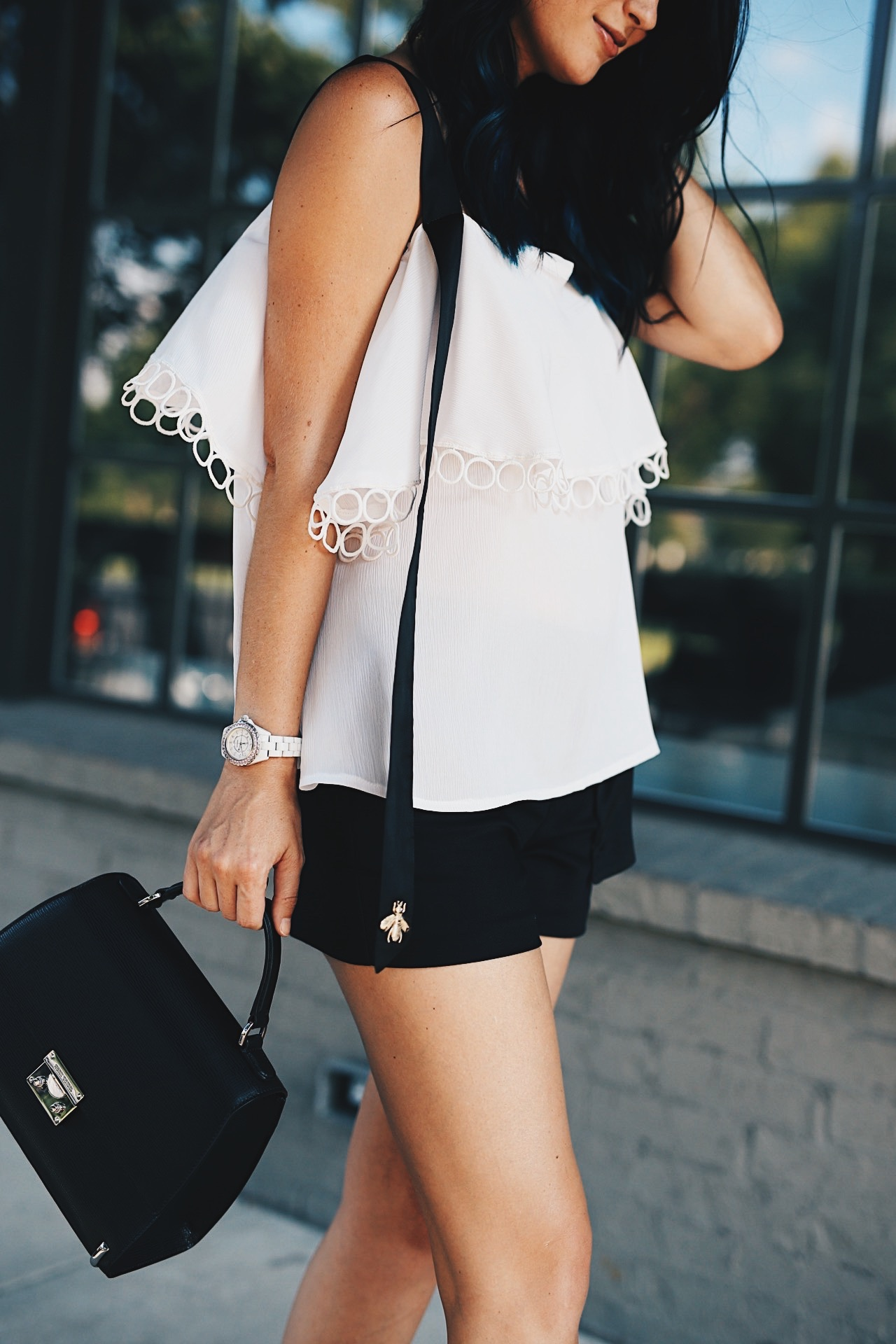 DTKAustin shares her love for black and white with this bee detailed top from Chicwish. Shoes from Splendid, Shorts from Alice & Olivia and bag from Henri Bendel. Click for more details and photos.    how to style a cold shoulder top   how to wear a cold shoulder top   cold shoulder top style tips   summer fashion tips   summer outfit ideas   summer style tips   what to wear for summer   warm weather fashion   fashion for summer   style tips for summer   outfit ideas for summer    Dressed to Kill