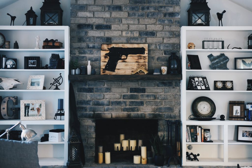 DTKAustin shares DIY tips on how to paint a brick fireplace white and how to brighten up a room up on a budget. Click for amazing before and after photos and more information.