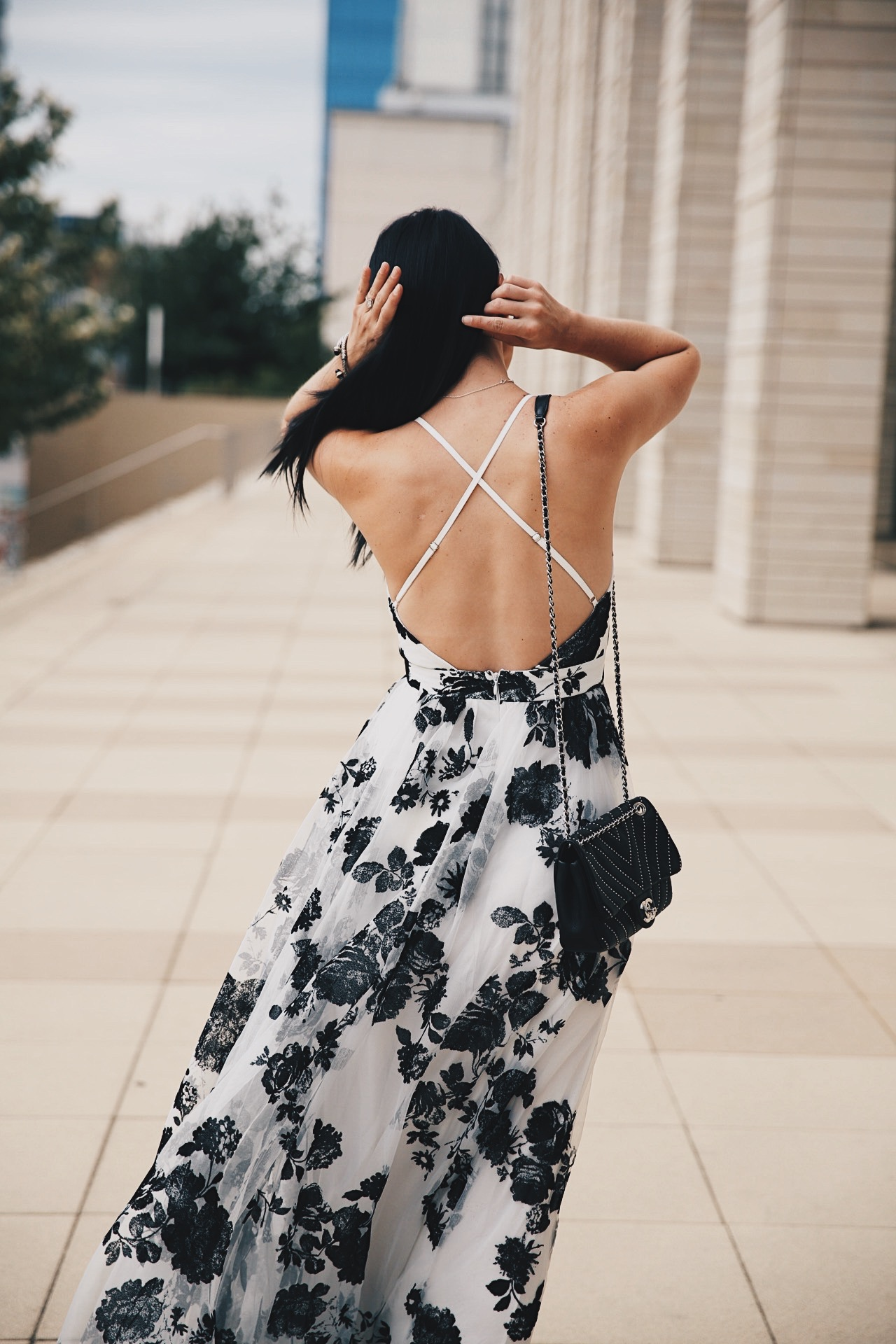 DTKAustin shares the most affordable black and white floral print maxi dress from Akira. Under $100 with a stunning criss-cross back it is perfect for date night. | how to wear a maxi dress | how to style a maxi dress | maxi dress style tips | summer fashion tips | summer outfit ideas | summer style tips | what to wear for summer | warm weather fashion | fashion for summer | style tips for summer | outfit ideas for summer || Dressed to Kill