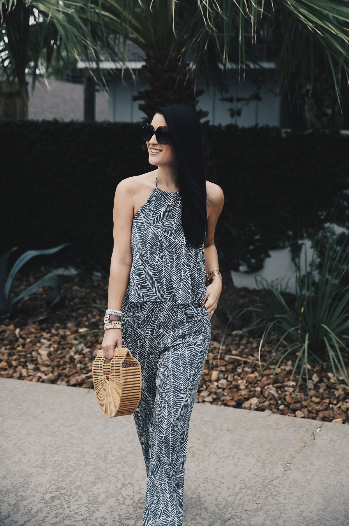 DTKAustin shares details on one of her go-to women's boutiques; Red Dress Boutique along with this beautiful palm print jumpsuit and Japanese bamboo bag. | how to style a jumpsuit | how to wear a jumpsuit | fall fashion tips | fall outfit ideas | fall style tips | what to wear for fall | cool weather fashion | fashion for fall | style tips for fall | outfit ideas for fall || Dressed to Kill