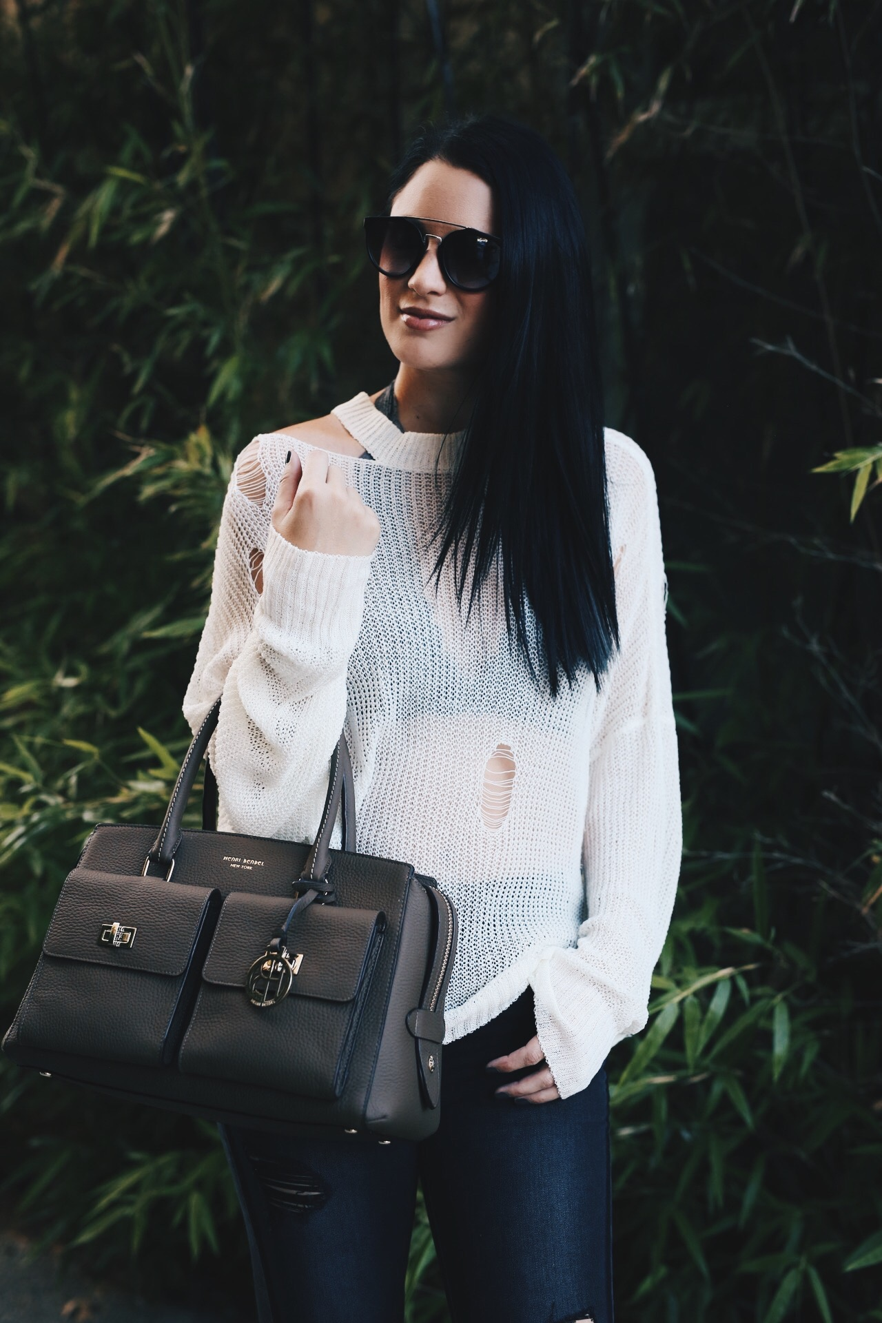 Austin Blogger DTKAustin is sharing how to pull off a sheer distressed sweater with ripped denim and how to still look put together. Handbag from Henri Bendel, sweater from Chicwish and denim from Express. Click for more photos and info. | how to wear a sheer sweater | fall fashion tips | fall outfit ideas | fall style tips | what to wear for fall | cool weather fashion | fashion for fall | style tips for fall | outfit ideas for fall || Dressed to Kill