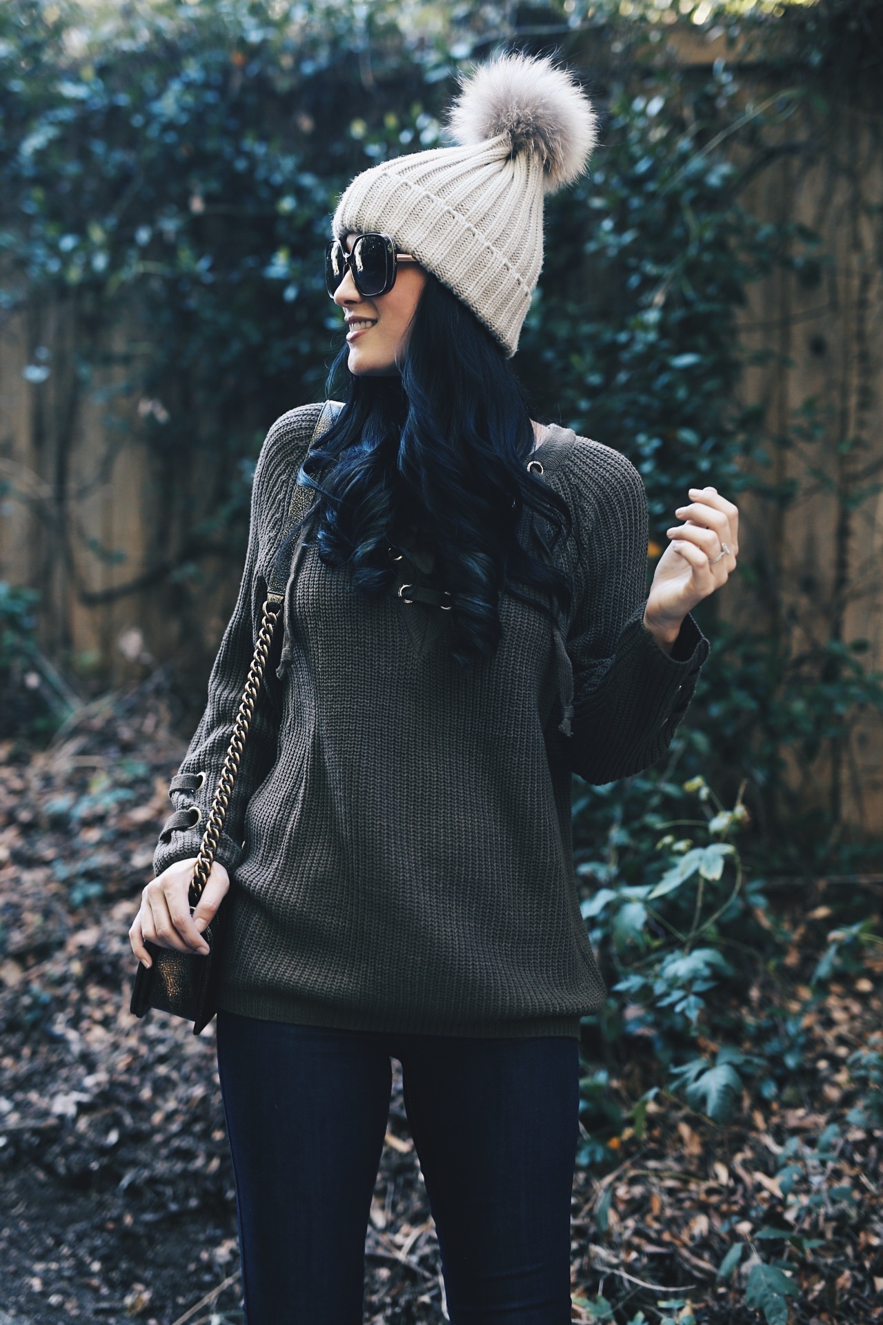 DTKAustin is sharing her fave olive green lace up sweater from Honeybum. Use code DTK20 for 20% your entire order. Bang - Chanel, Booties - Lucky Brand | olive green lace up fall sweater | how to style a lace up sweater | fall sweater fashion | fall fashion tips | fall outfit ideas | fall style tips | what to wear for fall | cool weather fashion | fashion for fall | style tips for fall | outfit ideas for fall || Dressed to Kill #fallstyle #fallsweaters #laceupsweater