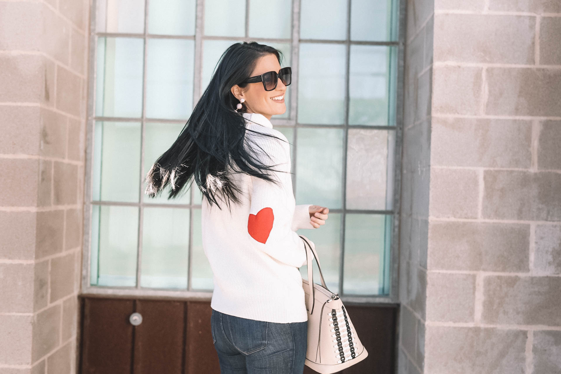 DTKAustin shares why she is dressing casual for Valentine's Day with this heart sleeve Chicwish turtleneck sweater. - Valentines Day Outfit idea from popular Austin Fashion blogger Dressed to Kill