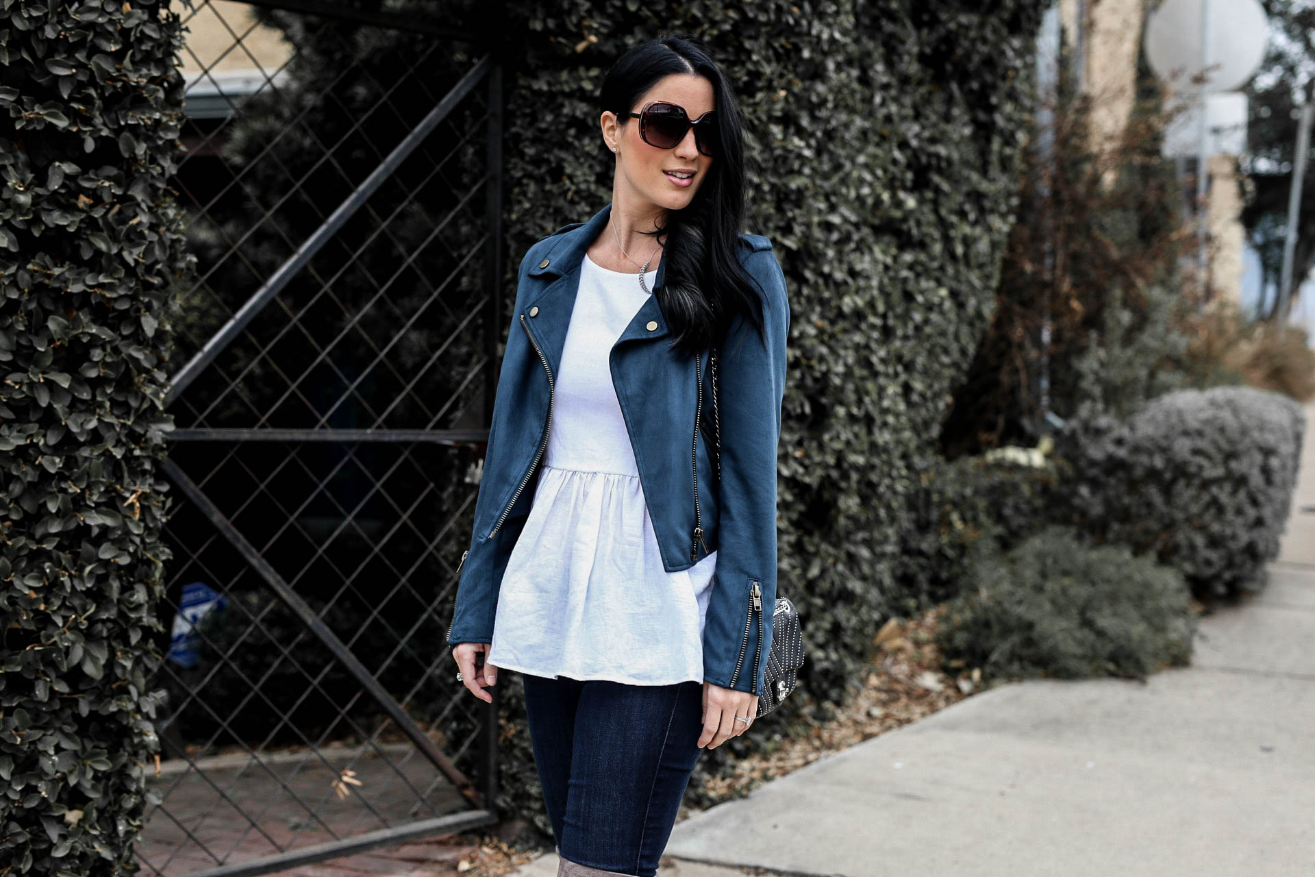 DTKAustin is sharing one of her favorite trends for every season; moto jackets. She is giving details on how to wear one and why you need to own a moto jacket. - Teal Moto Jacket by popular Austin style blogger Dressed to Kill