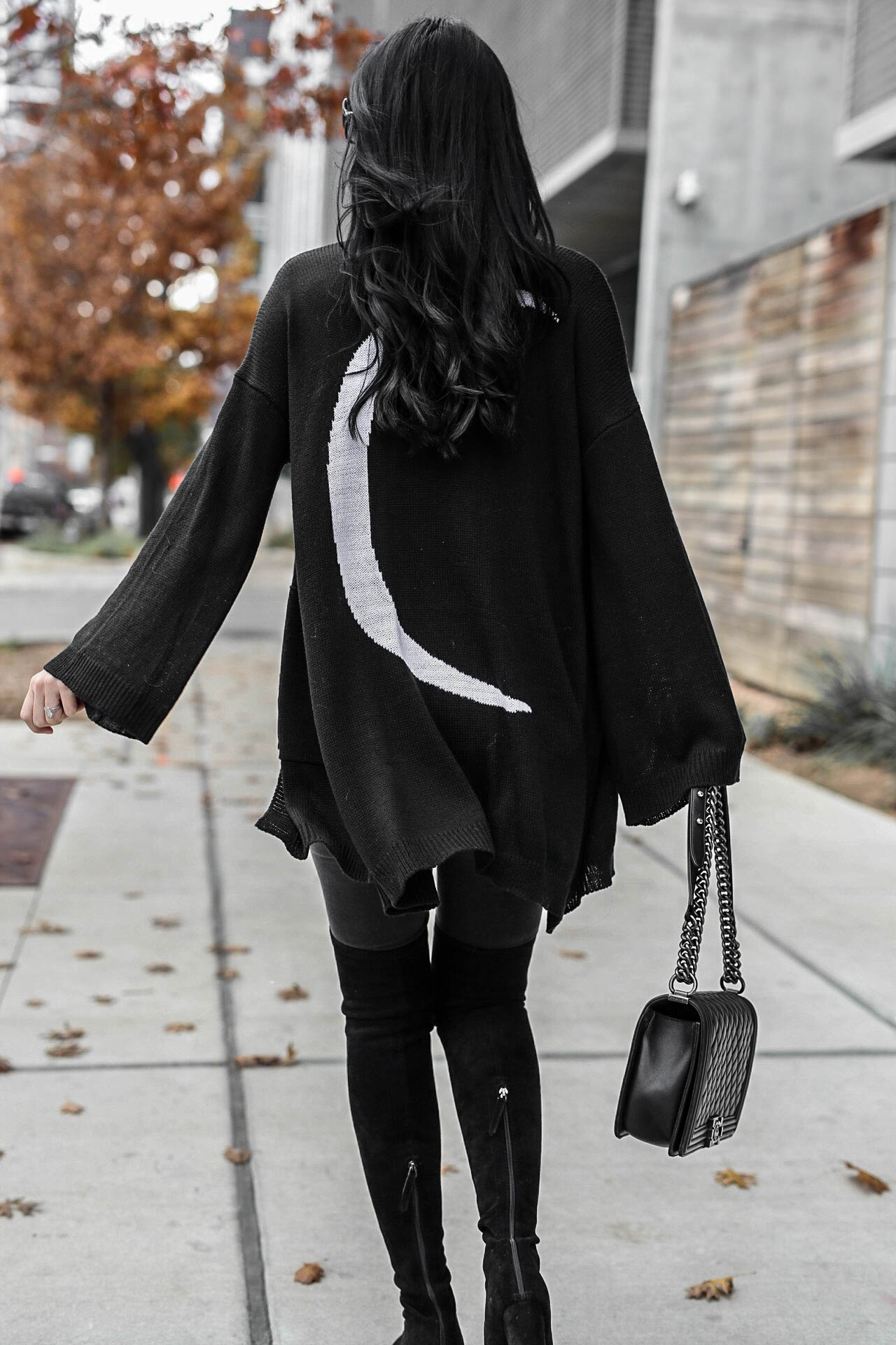 DTKAustin shares how to pull off an all black look as well as why she has an affinity for stars and moons. Cardigan from Show me Your Mumu. | black distressed jeans | Chanel handbag | OTK suede leather boots | all black fashion for women | all black outfit for winter | over the knee boots style || Dressed to Kill #otkboots #allblack #distressedjeans