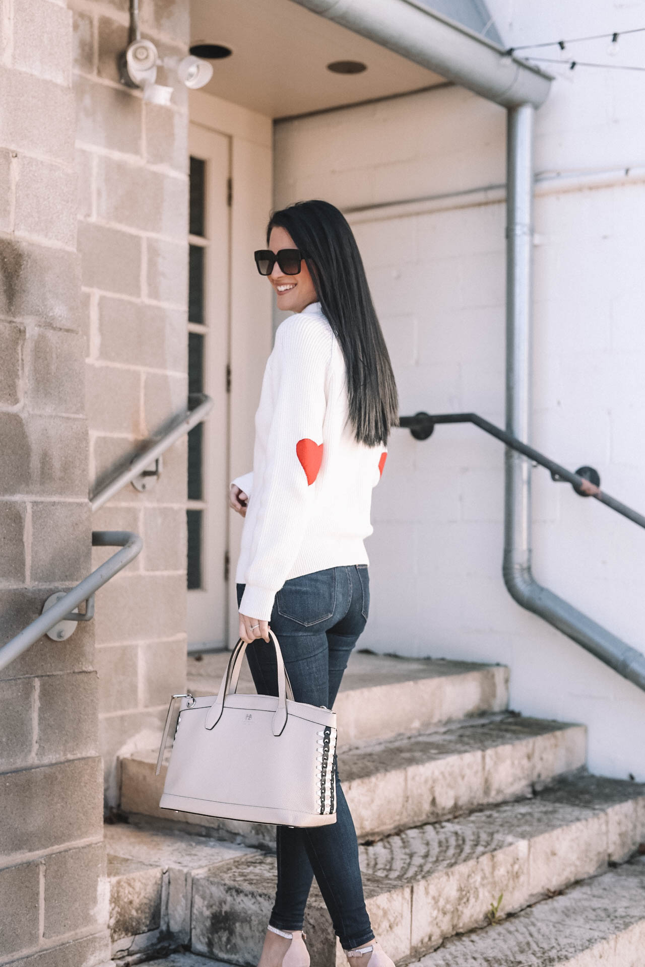 DTKAustin shares why she is dressing casual for Valentine's Day with this heart sleeve Chicwish turtleneck sweater. | Valentine's Day outfits | heart inspired outfits | Valentine's Day sweater | Valentine's Day outfit for women || Dressed to Kill #valentineoutfit #vdayoutfit #valentinesweater - Valentines Day Outfit idea from popular Austin Fashion blogger Dressed to Kill