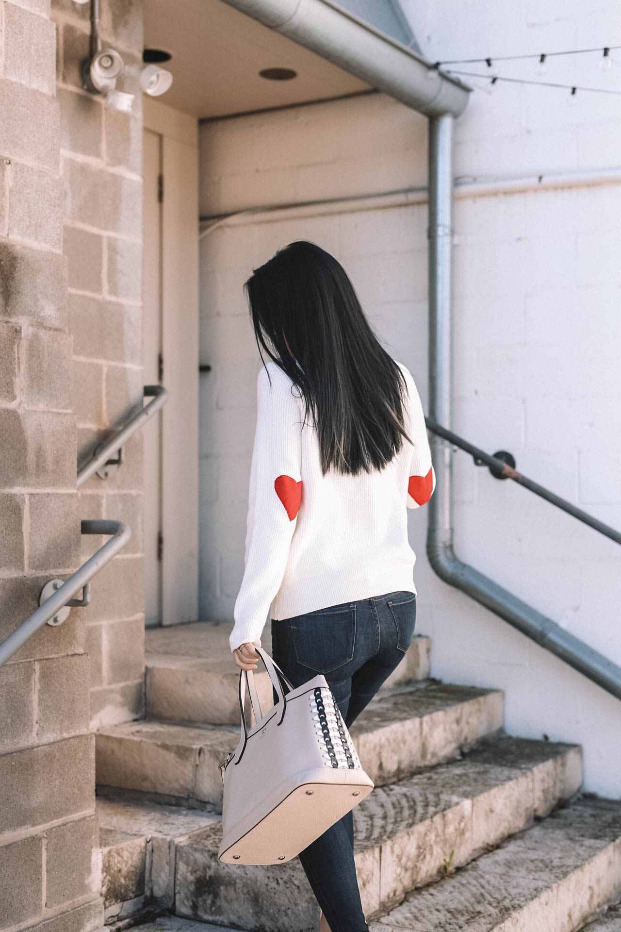 DTKAustin shares why she is dressing casual for Valentine's Day with this heart sleeve Chicwish turtleneck sweater. | Valentine's Day outfits | heart inspired outfits | Valentine's Day sweater | Valentine's Day outfit for women || Dressed to Kill #valentineoutfit #vdayoutfit #valentinesweater- Valentines Day Outfit idea from popular Austin Fashion blogger Dressed to Kill