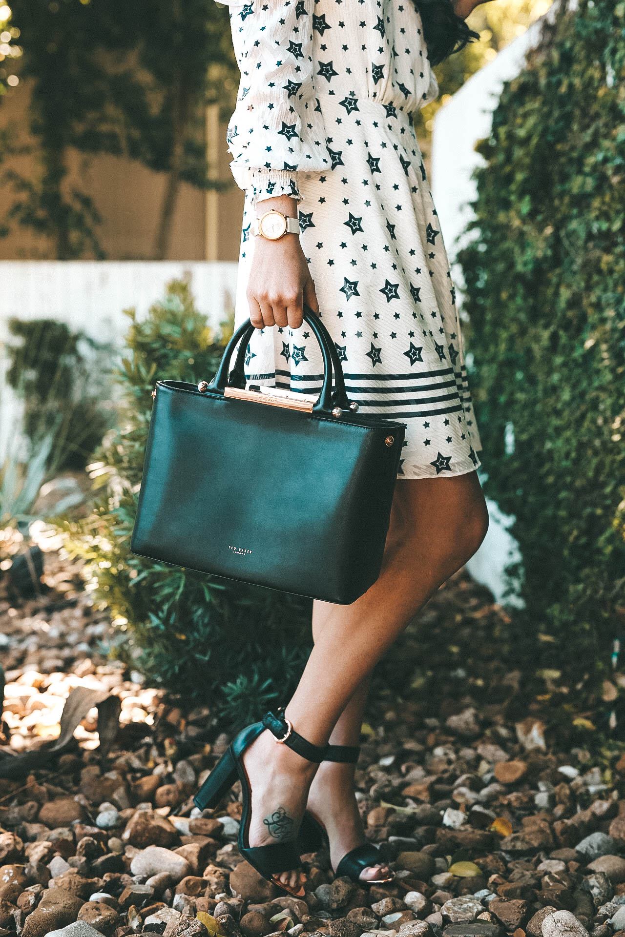 DTKAustin talks Spring looks and outfits with one of her favorite designers, Ted Baker. Star print dress, leather tote and leather sandals all Ted Baker. || Dressed to Kill #springoutfit #tedbaker #printdress #leathertote #dresses #fashion #style - Ted Baker Dress styled by popular Austin fashion blogger Dressed to Kill