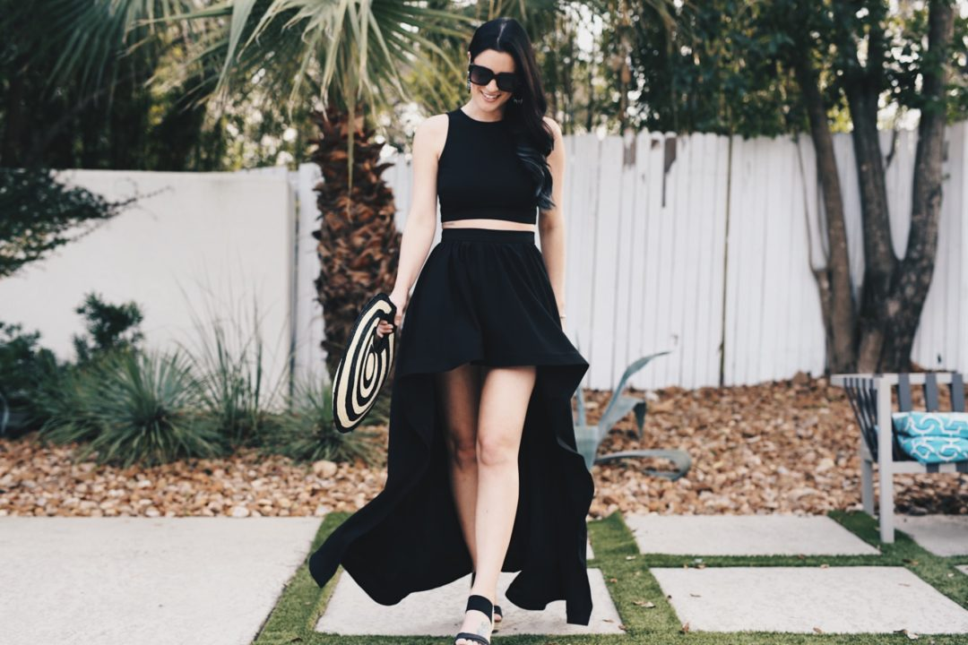 DTKAustin shares one of her most dramatic summer looks; a back two piece, high low skirt set from Akira with a straw round bag from Anthropologie. - Akira Clothing outfit styled by popular Austin fashion blogger Dressed to Kill