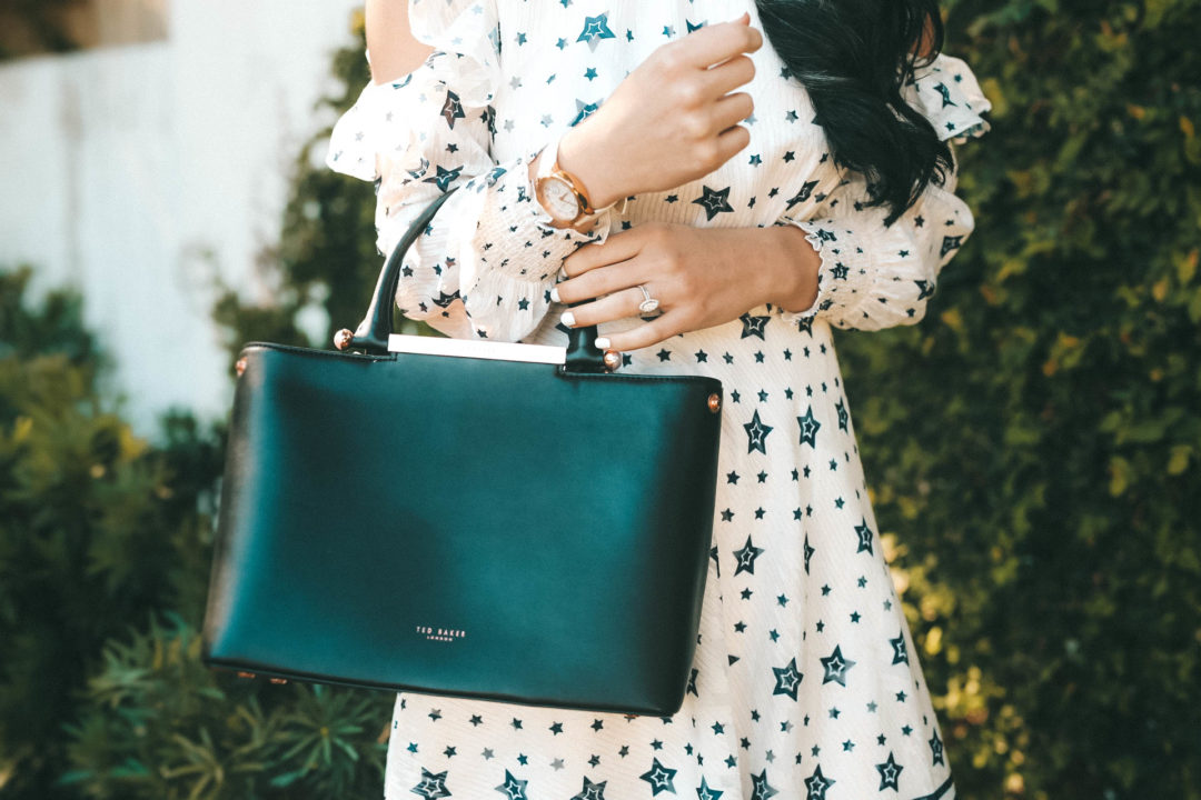DTKAustin talks Spring looks and outfits with one of her favorite designers, Ted Baker. Star print dress, leather tote and leather sandals all Ted Baker. - Ted Baker Dress styled by popular Austin fashion blogger Dressed to Kill
