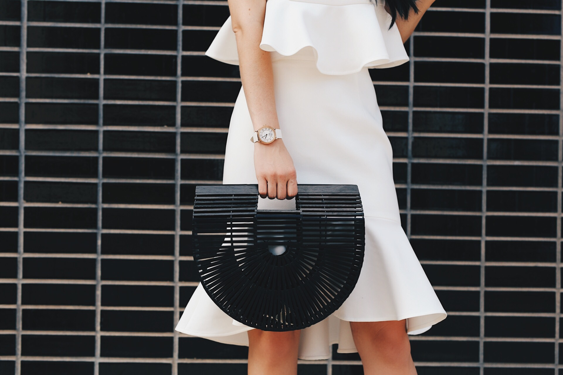 DTKAustin shares a versatile white top and skirt set from Chicwish. Perfect for Spring/Summer and the upcoming Kentucky Derby. Black Bamboo bag from Red Dress Boutique or Cult Gaia. - White Two Piece Set styled by popular Austin fashion blogger, Dressed to Kill
