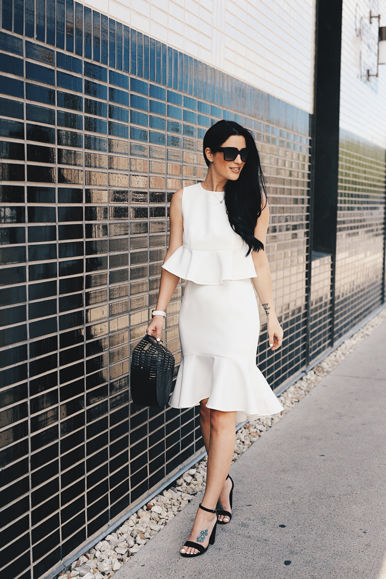 DTKAustin shares a versatile white top and skirt set from Chicwish. Perfect for Spring/Summer and the upcoming Kentucky Derby. Black Bamboo bag from Red Dress Boutique or Cult Gaia. || Dressed to Kill #fashion #style #springstyle - White Two Piece Set styled by popular Austin fashion blogger, Dressed to Kill