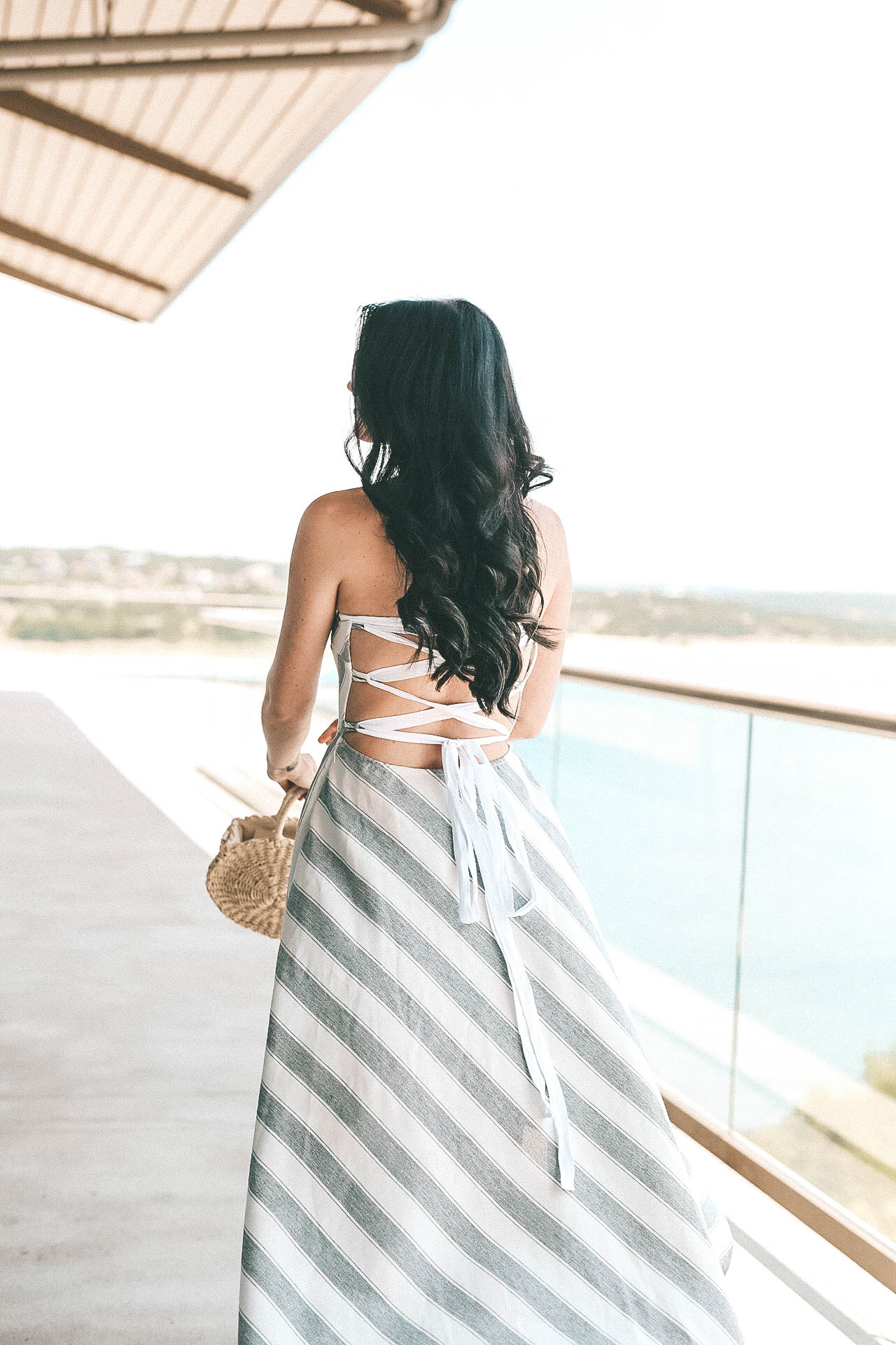 DTKAustin shares an affordable lace up maxi dress perfect for summer. Dress is AKIRA, bag is Clare V, shoes Steve Madden. | summer dresses for women | summer style | summer fashion | summer outfits for women | how to style a lace up dress || Dressed to Kill #fashion #style #womensoutfit #laceupdress #summerdress #summerfashion #summerstyle #dtkaustin - {The Lace-Up Dress of Your Dreams} featured by popular Austin fashion blogger, Dressed to Kill