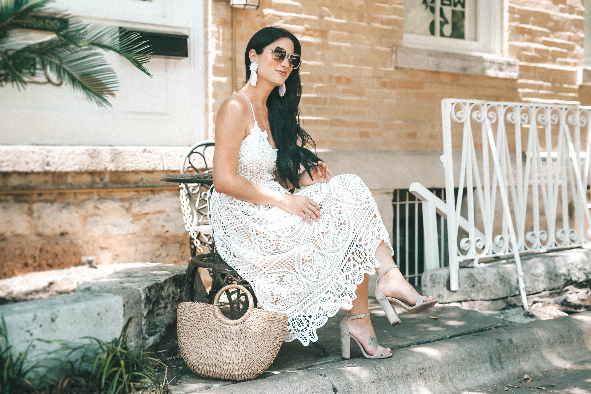 Beautiful lace up back detail with Baublebar statement earrings. - The Most Versatile White Lace Dress for Summer featured by popular Austin fashion blogger Dressed to Kill