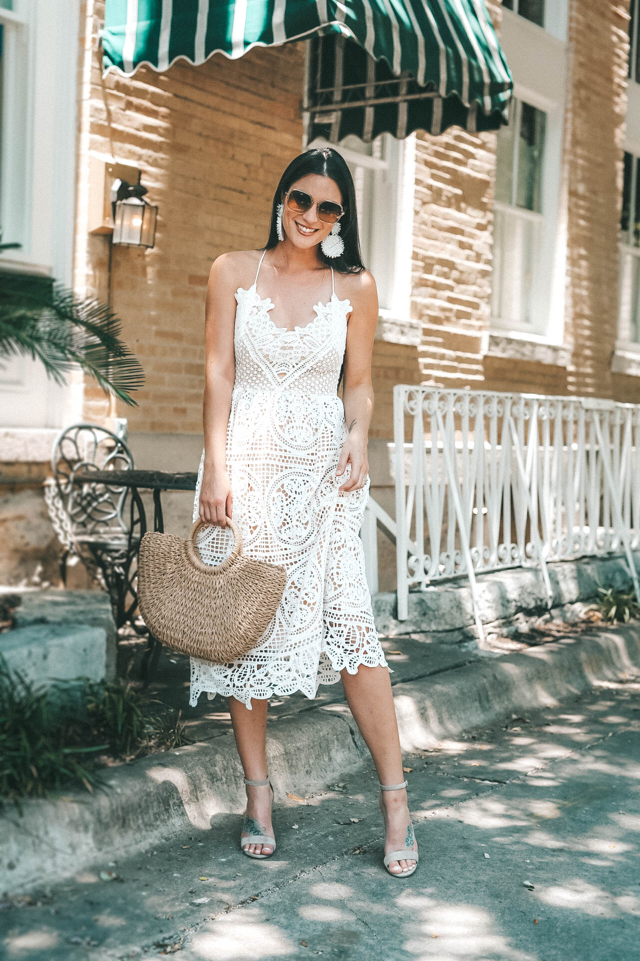 Beautiful lace up back detail with Baublebar statement earrings. - The Most Versatile White Lace Dress for Summer featured by popular Austin fashion blogger Dressed to Kill #fashion #style #whitedress #dresses #womensoutfit #womensfashion #outfits #white #summerfashion #dtkaustin