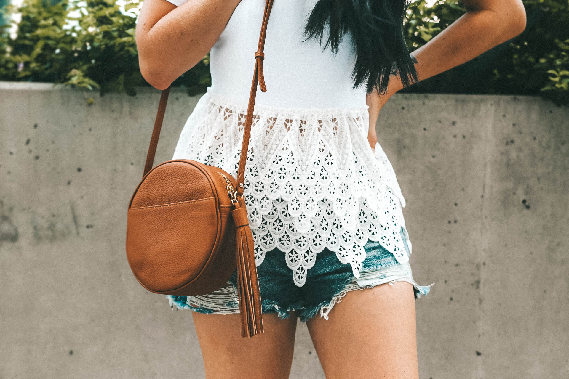 the perfect white lace peplum top for summer from Chicwish. It is under $30 and an affordable staple top. - {How to Wear a Crochet Peplum Top + Why They are so Flattering} featured by popular Austin fashion blogger Dressed to Kill