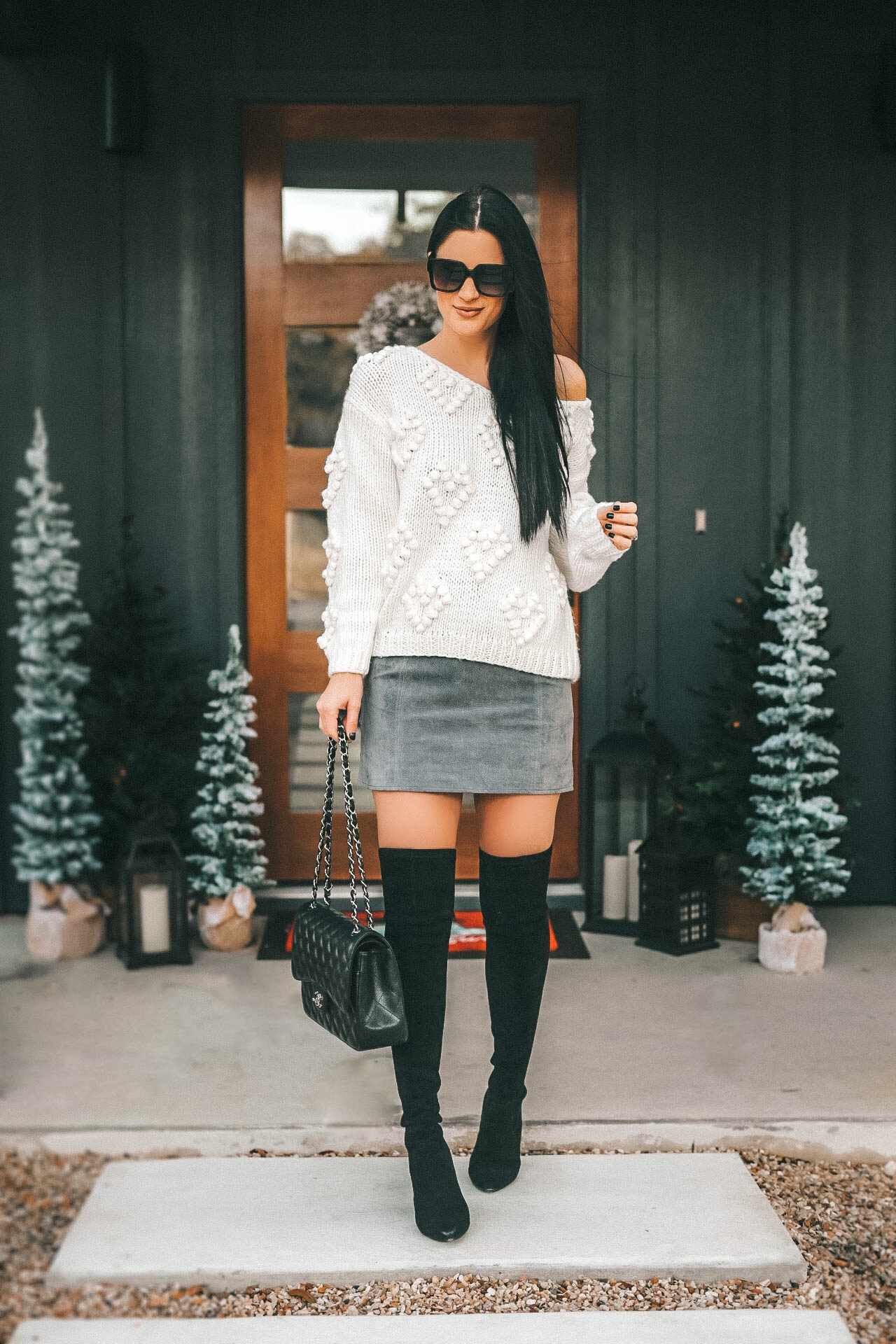 DTKAustin is sharing 10 Must Have knitted heart sweaters and cardigans from Chicwish for Fall and Winter. Suede OTK boots are Goodnight Macaroon, Handbag is a Chanel Jumbo, Suede skirt from BlankNYC. | Knit Cardigan for Fall | how to style a knit cardigan | knit cardigan outfit || Dressed to Kill #fashion #style #womensoutfit #womensfashion #cardigan #knit #knitcardigan #fallstyle #streetstyle #fallfashion #dtkaustin | Cozy Sweaters from Dressed to Kill