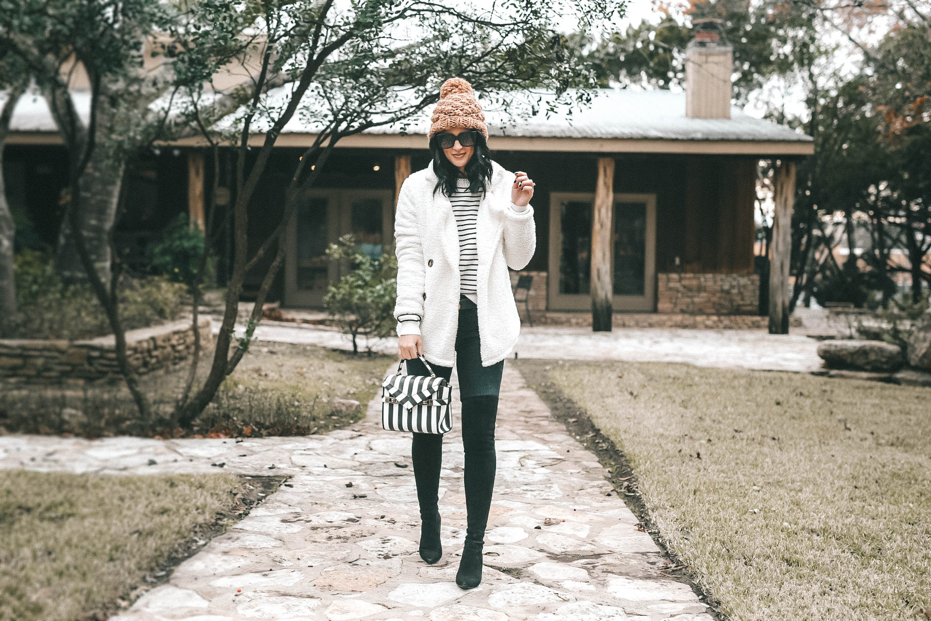DTKAustin is sharing the most affordable beaded striped sweater from Chicwish. It is hand beaded with faux pearls and on sale for $45. Handbag is Henri Bendel, Over the Knee Boots Goodnight Macaroon, Teddy Bear coat is Goodnight Macaroon, Knit beanie is Abercrombie. || Dressed to Kill #fashion #style #womensoutfit #womensfashion #stripedsweater #knit #knitsweater #winterstyle #streetstyle #winterfashion #dtkaustin