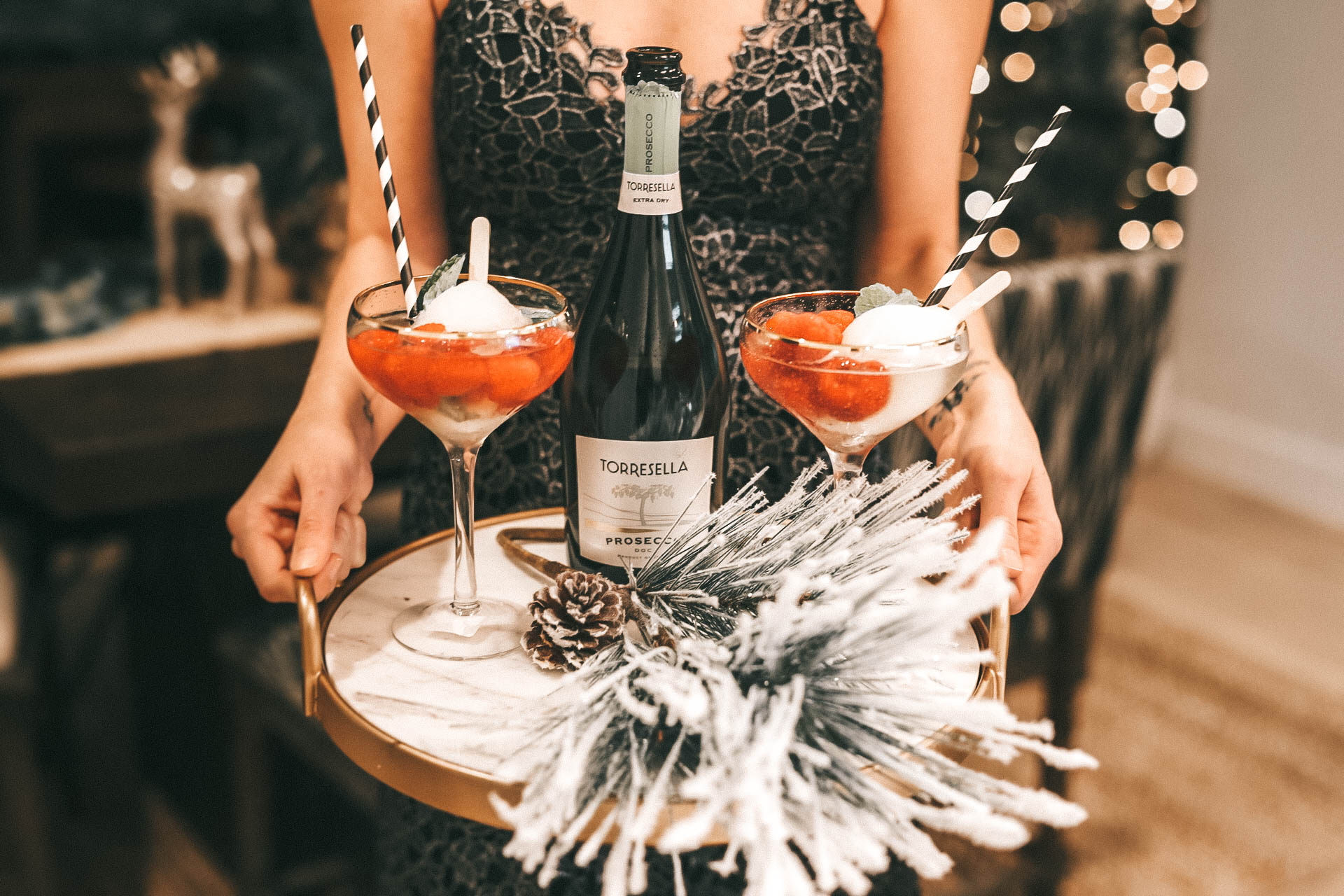DTKAustin is sharing 2 EASY Cocktail Drinks for Your Holiday Party with Recipes frmo Torresella Wines. One is a White Wine Spritzer and the other is Prosecco Pop! Holiday Dress is ASTR, Earrings are Baublebar, Holiday Table decor is World Market || Dressed to Kill #christmastabledecor #christmasdrinks #christmasparty #holidaydrinks #holidayparty #hostingparty #torresella #torresellawine #dtkaustin