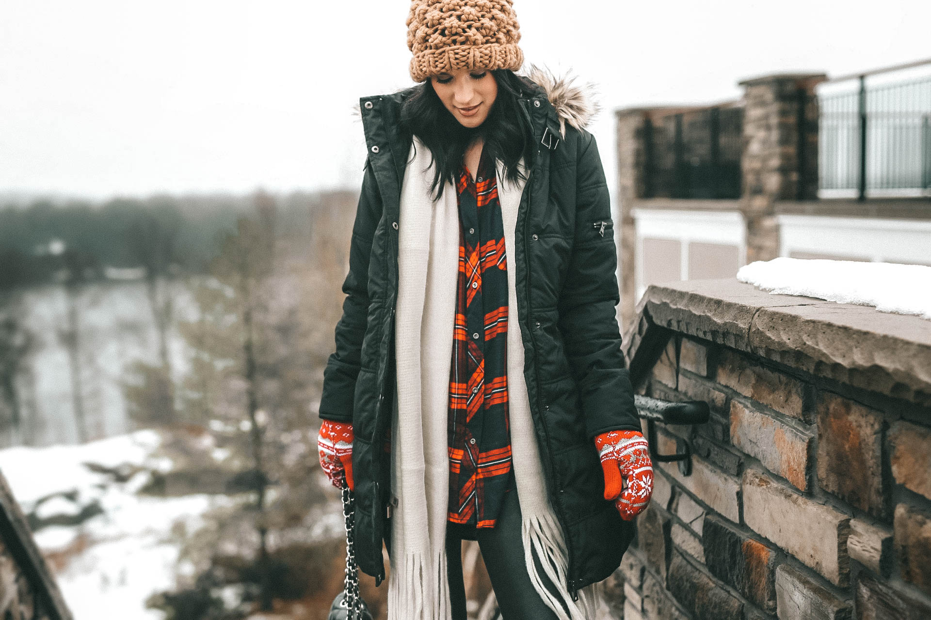 The Rosseau Muskoka featured by top US travel blog Dressed to Kill; Woman in cute winter outfit