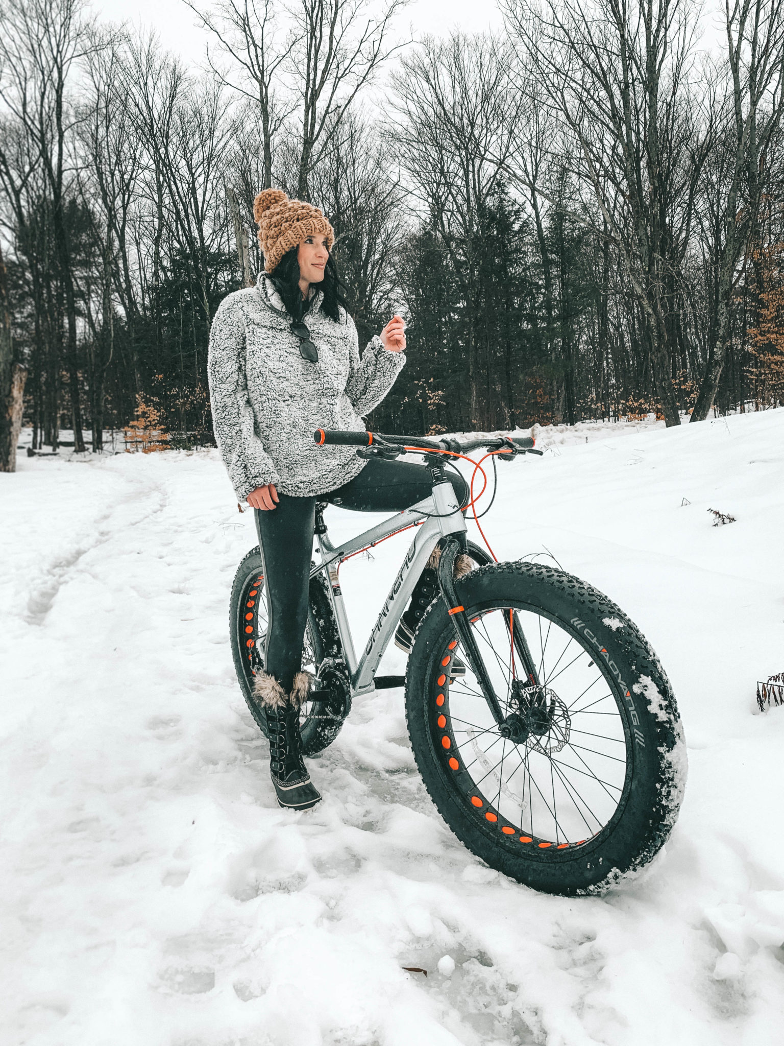 The Rosseau Muskoka featured by top US travel blog Dressed to Kill; Girl riding a bike in the snow.