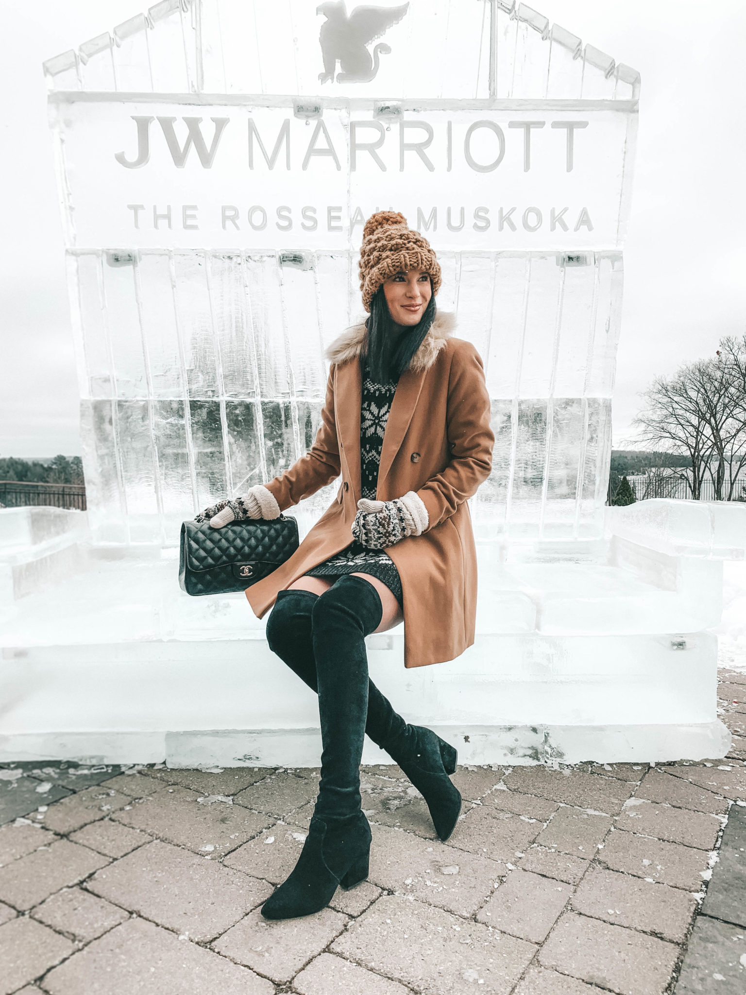 The Rosseau Muskoka featured by top US travel blog Dressed to Kill; Girl in cute black and brown winter outfit.